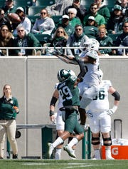 Michigan State's Darrell Stewart Jr., right, catches a pass over Shakur Brown (29) during an NCAA college football spring scrimmage game, Saturday, April 13, 2019, in East Lansing, Mich. (AP Photo/Al Goldis)