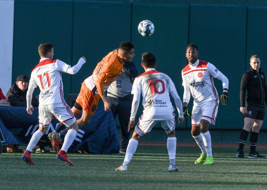 Lansing Ignite's Ivo Cerda heads the ball against the Richmond Kickers Saturday, April 13, 2019. Lansing won their first home match 3-1.