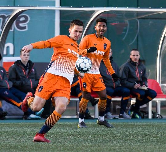 Lansing Ignite defender Grant Stoneman (4) kicks the ball away against the Richmond Kickers Saturday, April 13, 2019. Lansing won 3-1.