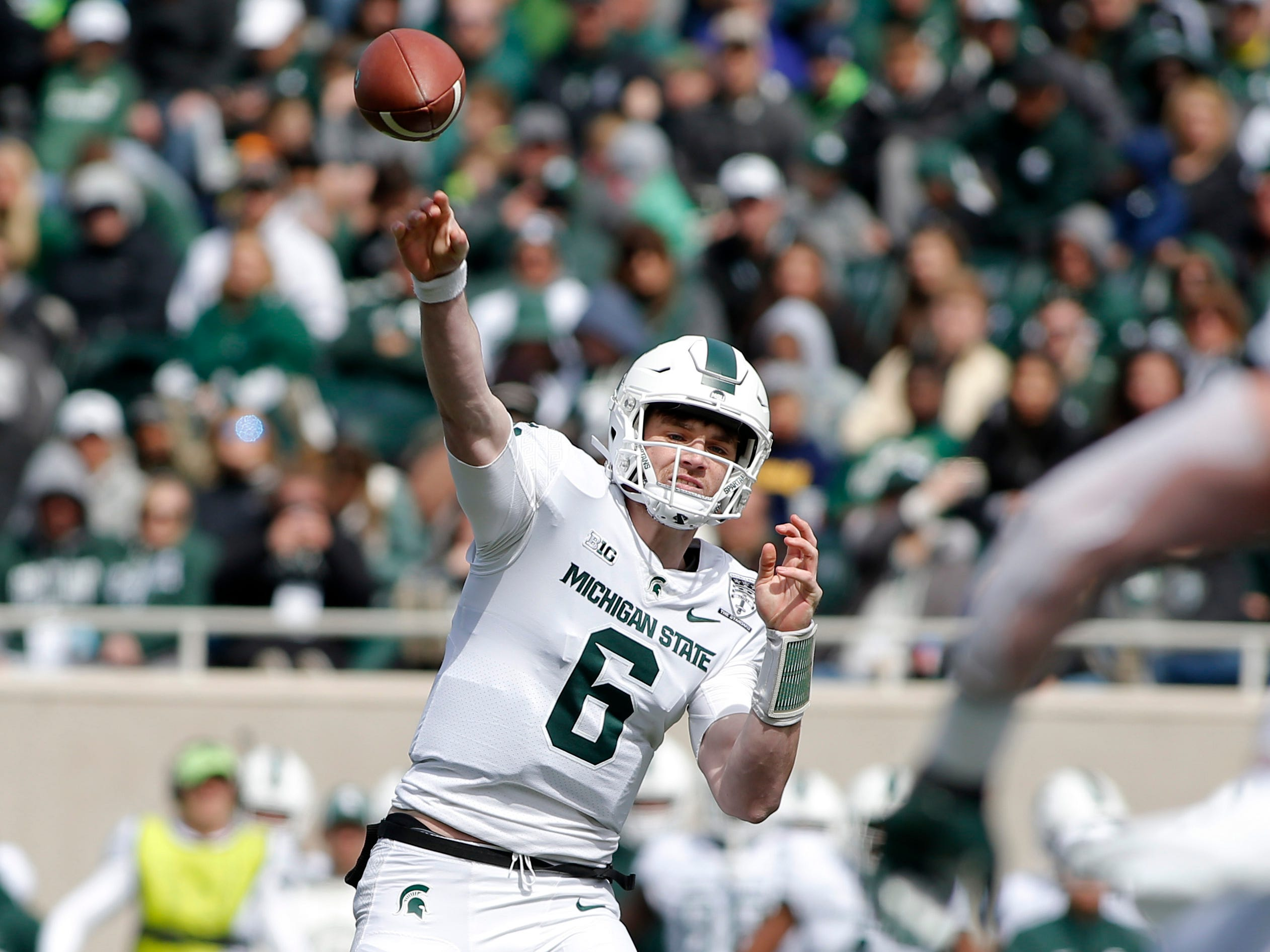 Michigan State quarterback Theo Day throws during an NCAA college football spring scrimmage game, Saturday, April 13, 2019, in East Lansing, Mich. (AP Photo/Al Goldis)