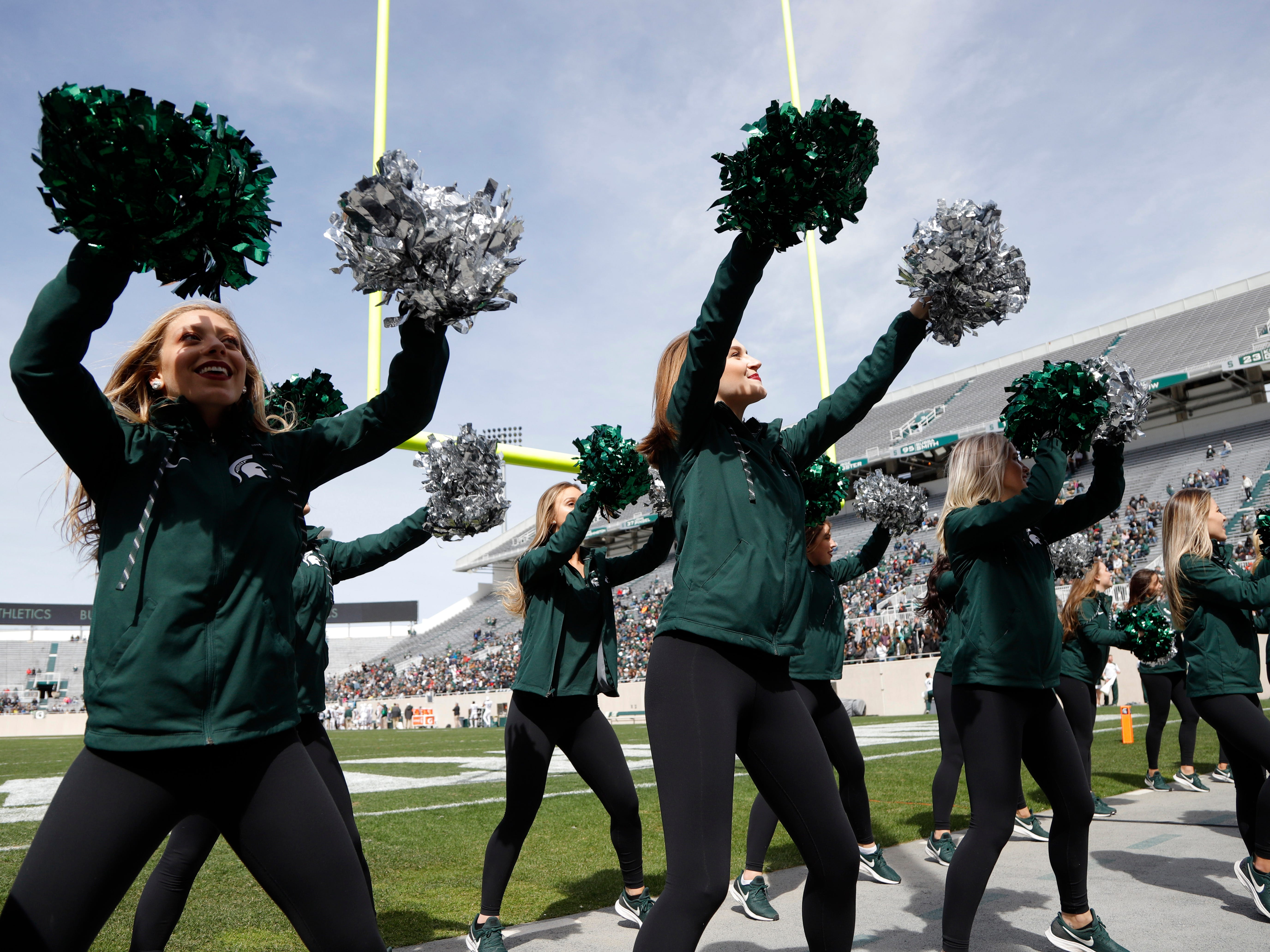 Michigan State dance team members perform during an NCAA college football spring scrimmage game, Saturday, April 13, 2019, in East Lansing, Mich. (AP Photo/Al Goldis)