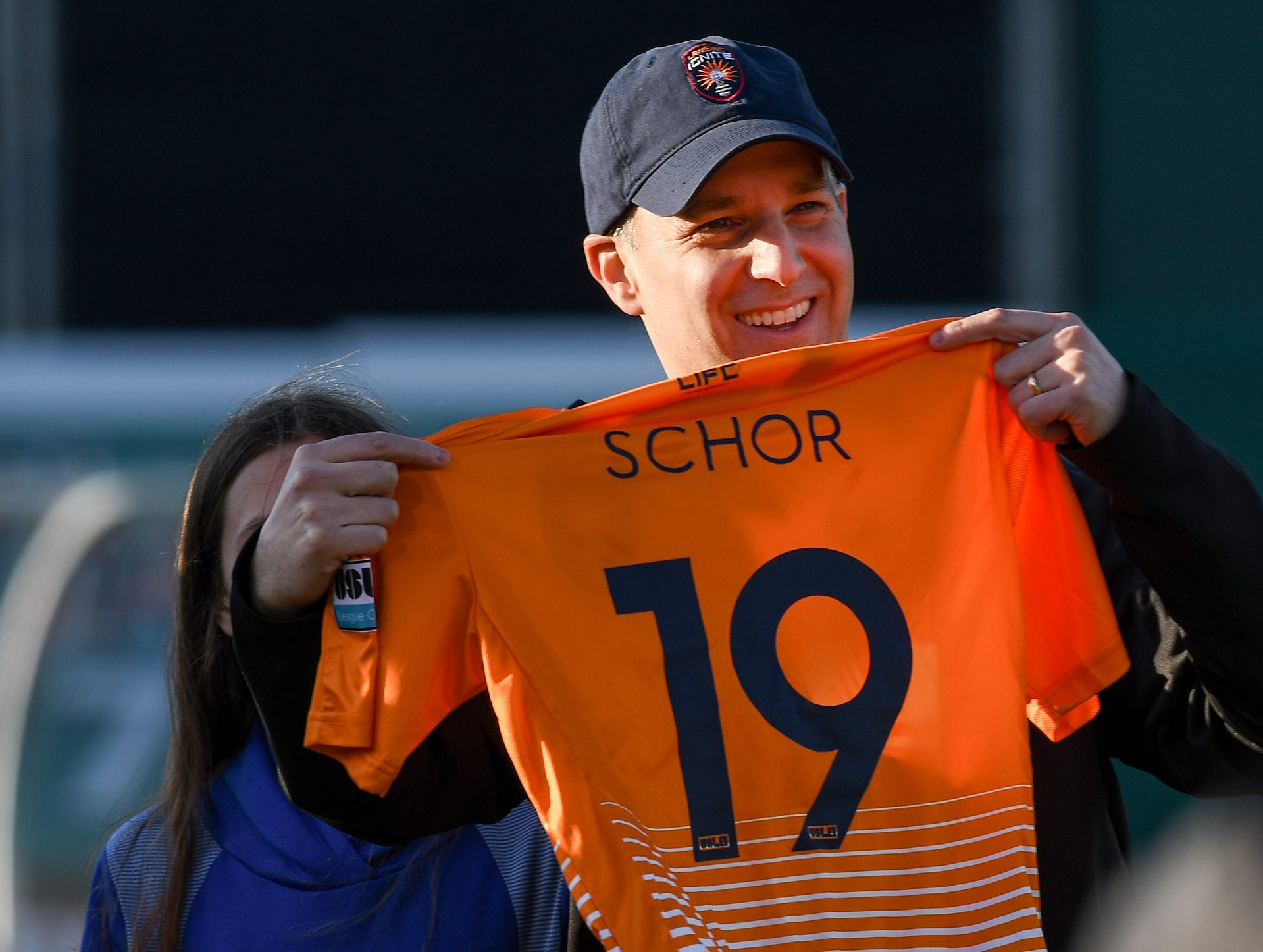 Lansing Mayor Any Schor is presented with a Lansing Ignite jersey at the start of the first home match of the new professional soccer team Saturday, April 13, 2019.