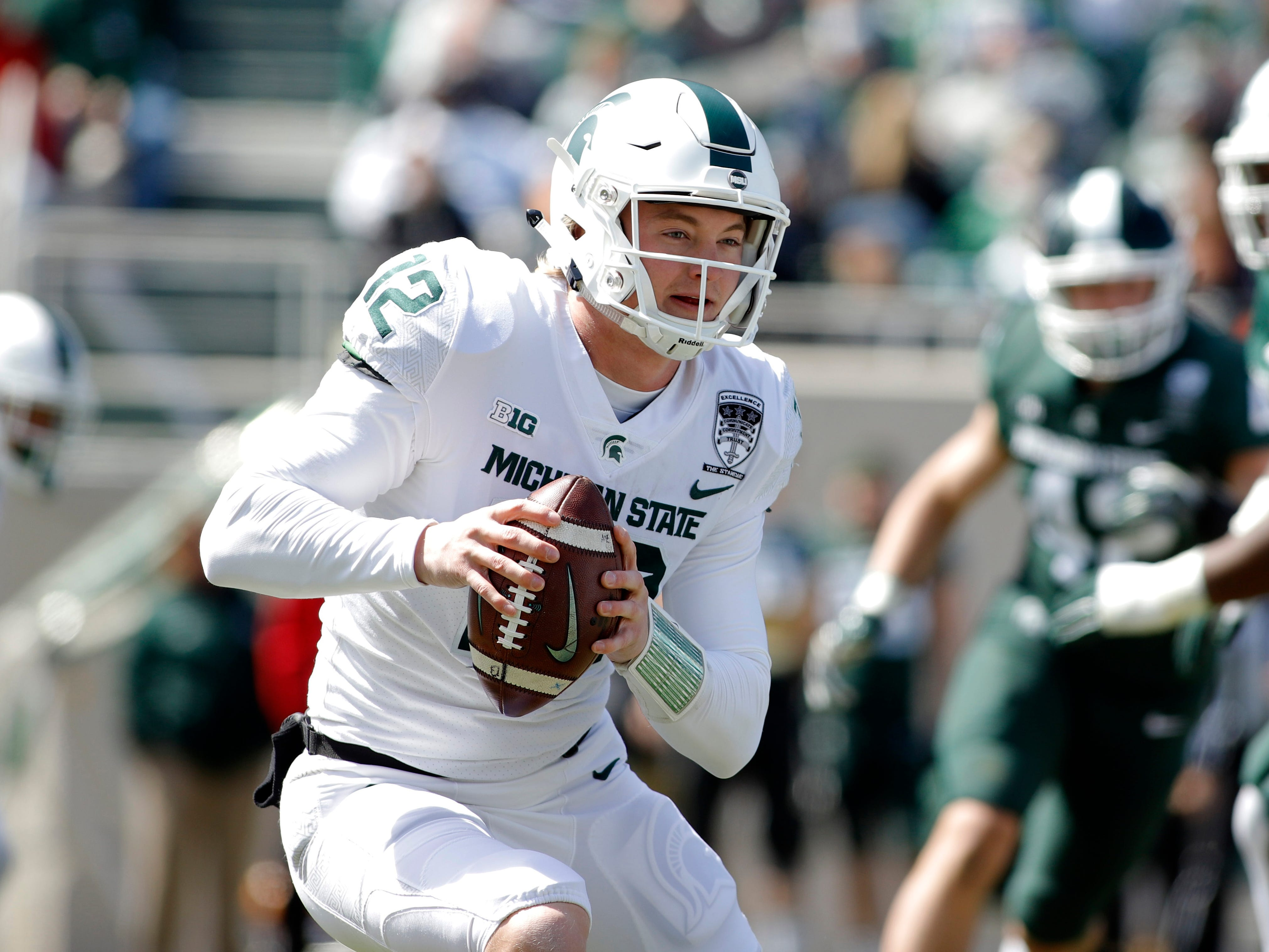 Michigan State quarterback Rocky Lombardi scrambles during an NCAA college football spring scrimmage game, Saturday, April 13, 2019, in East Lansing, Mich. (AP Photo/Al Goldis)