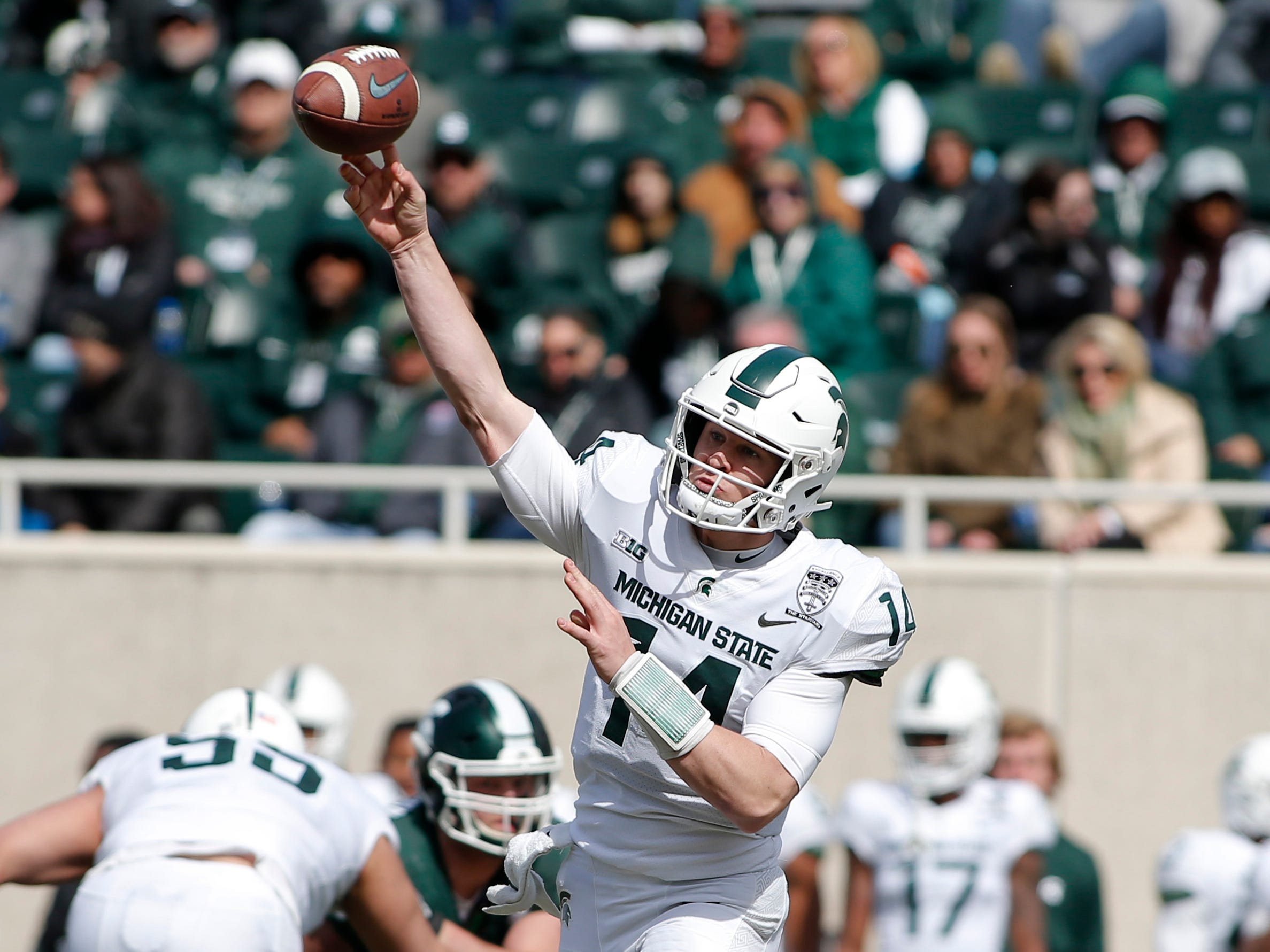 Michigan State quarterback Brian Lewerke throws a pass during an NCAA college football spring scrimmage game, Saturday, April 13, 2019, in East Lansing, Mich. (AP Photo/Al Goldis)