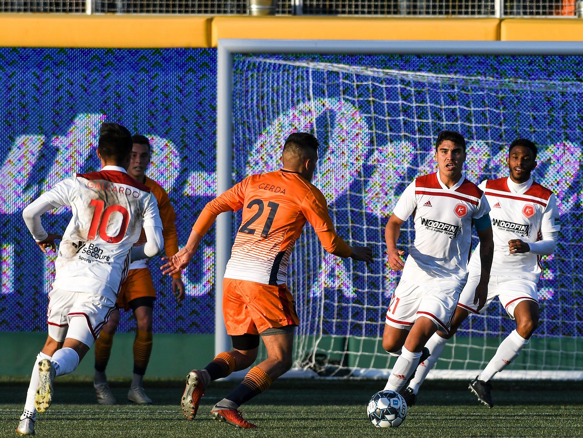 Lansing Ignite midfielder Ivo Cerda (21) tries a shot against Richmond Kickers Saturday, April 13, 2019.