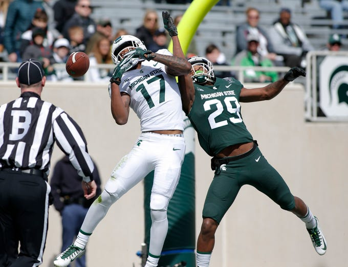 Michigan State's Shakur Brown, right, breaks up a pass intended for Tre Mosley (17) during an NCAA college football spring scrimmage game, Saturday, April 13, 2019, in East Lansing, Mich. (AP Photo/Al Goldis)