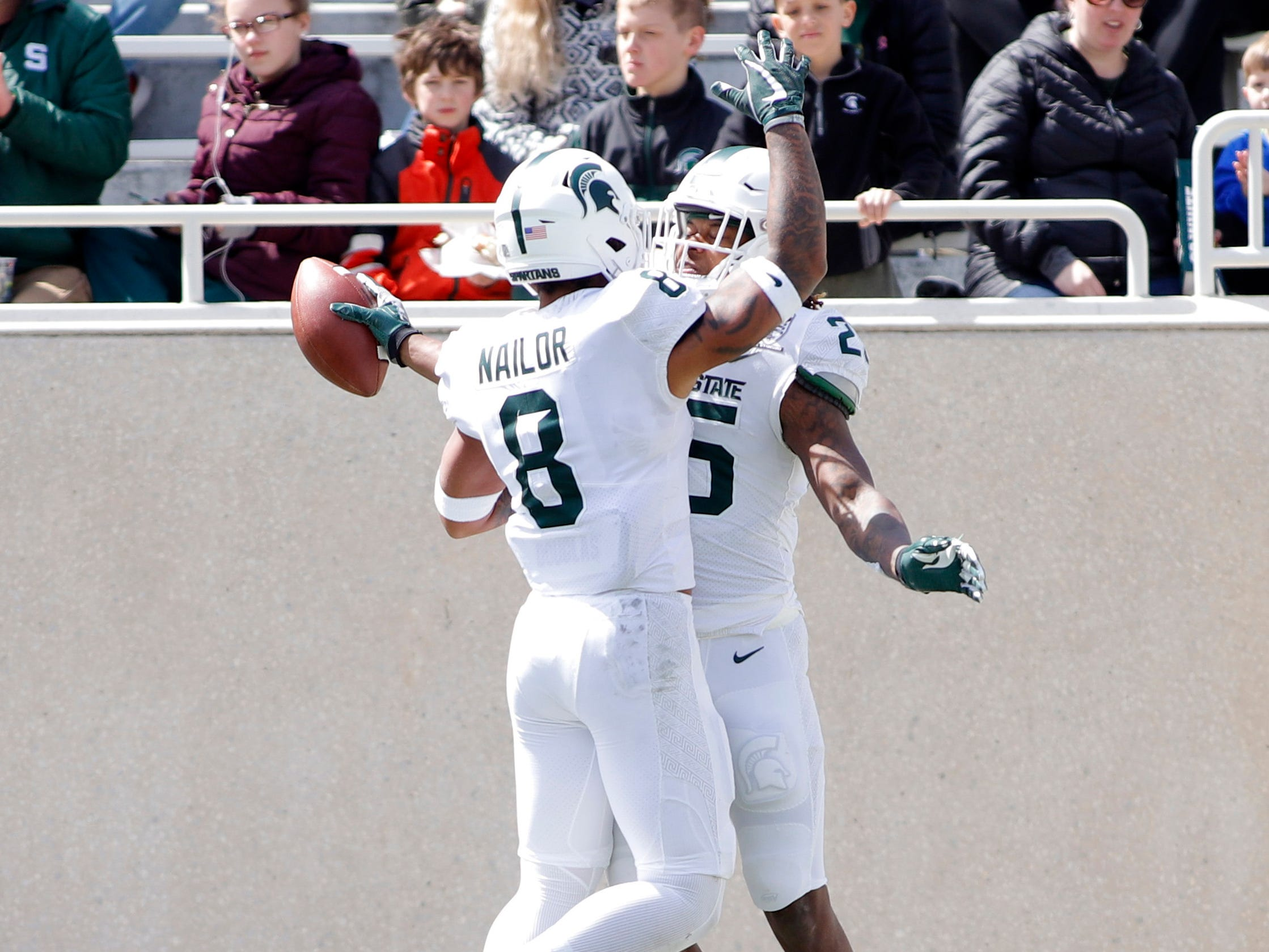 Michigan State receivers Darrell Stewart Jr., right, and Jalen Nailor (8) celebrate Stewart's touchdown during an NCAA college football spring scrimmage game, Saturday, April 13, 2019, in East Lansing, Mich. (AP Photo/Al Goldis)