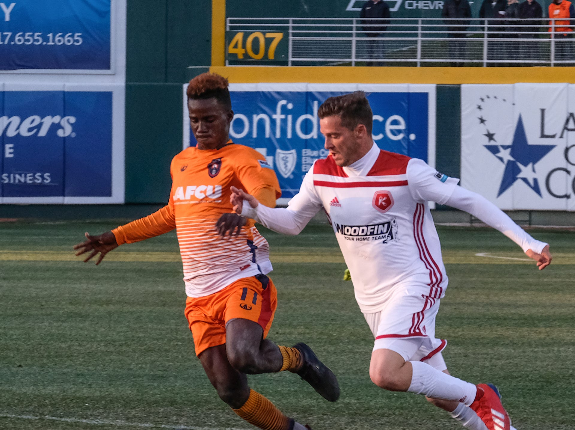 Lansing Ignite's Steeve Saint-Duc (11) left and Matt Bolduc from Richmond tangle in the first home match for the Lansing Ignite Saturday, April 13, 2019.