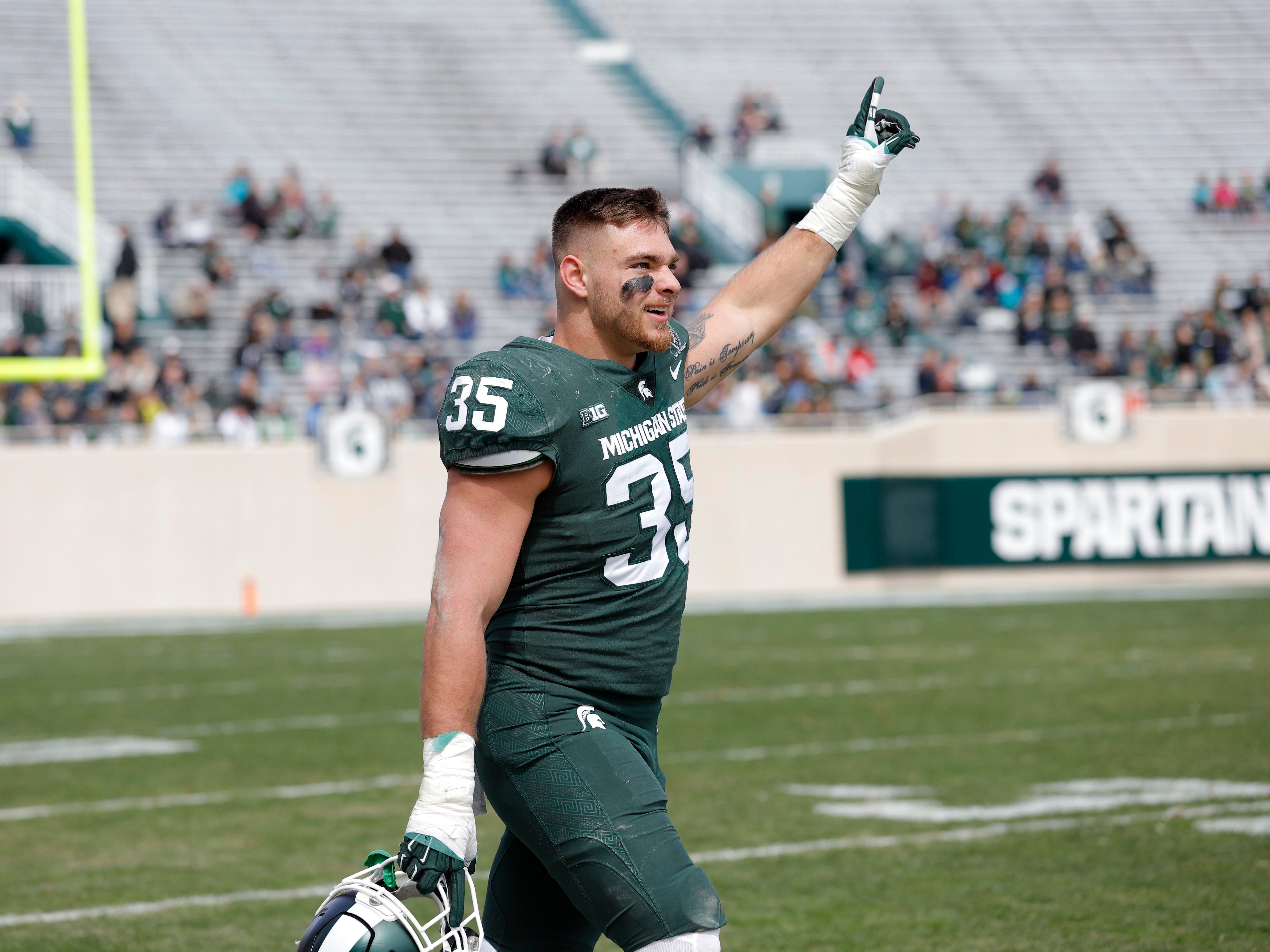 Michigan State lineback Joe Bachie reacts during an NCAA college football spring scrimmage game, Saturday, April 13, 2019, in East Lansing, Mich. (AP Photo/Al Goldis)