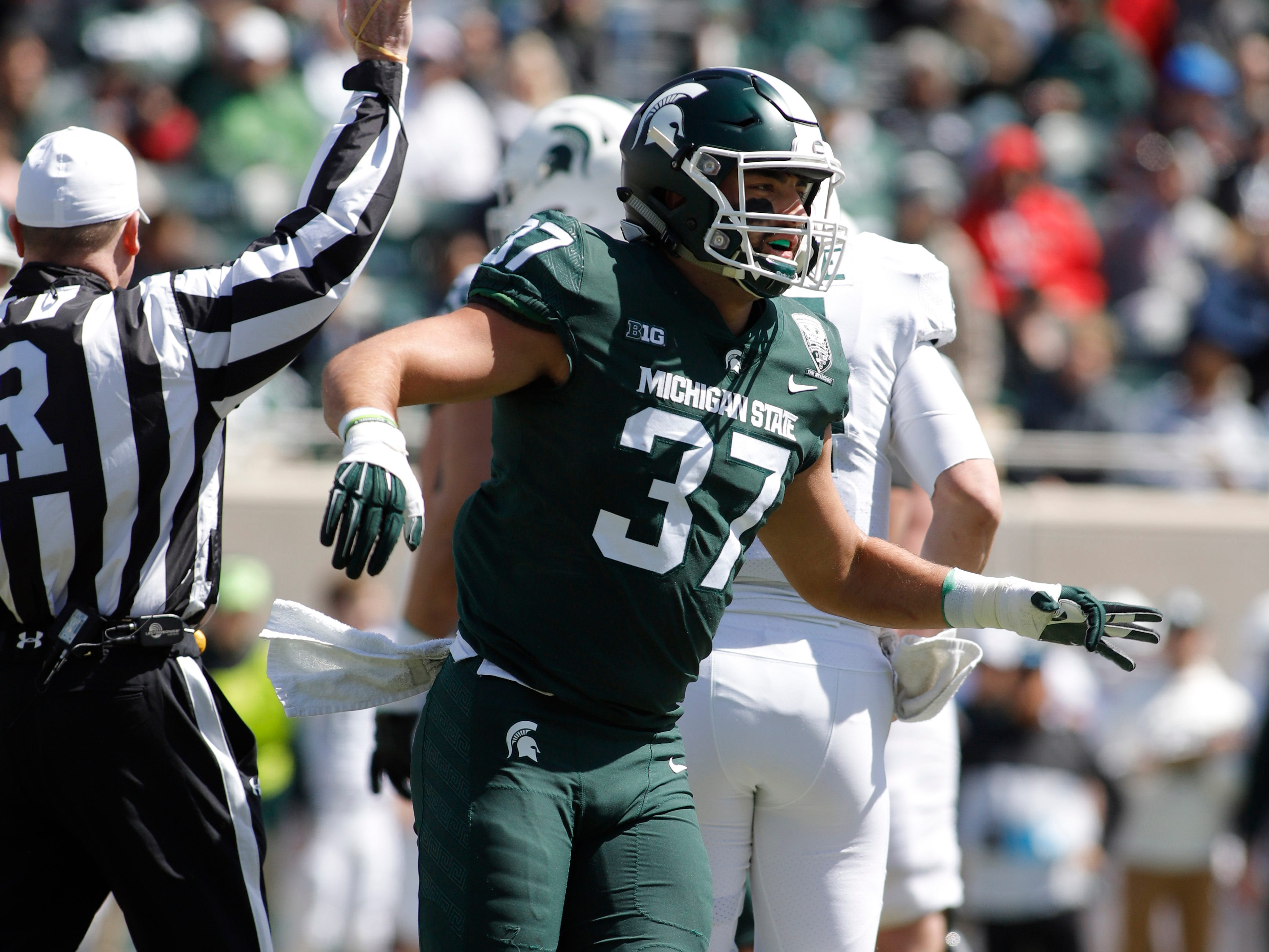 Michigan State's Dante Razzano celebrates a play during an NCAA college football spring scrimmage game, Saturday, April 13, 2019, in East Lansing, Mich. (AP Photo/Al Goldis)