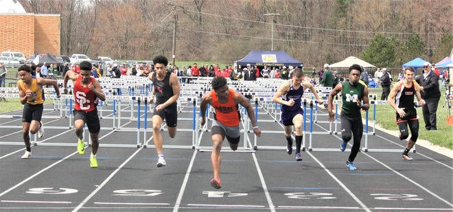 Mansfield Senior's Angelo Grose leans at the finish in adding a title in the 110 high hurdles to his gold medal in the long jump at Saturday's 87th Mehock Relays.