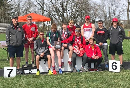 Coach Chris Zuercher and his Shelby Whippets with their runner-up plaque at Saturday's 87th Mehock Relays.