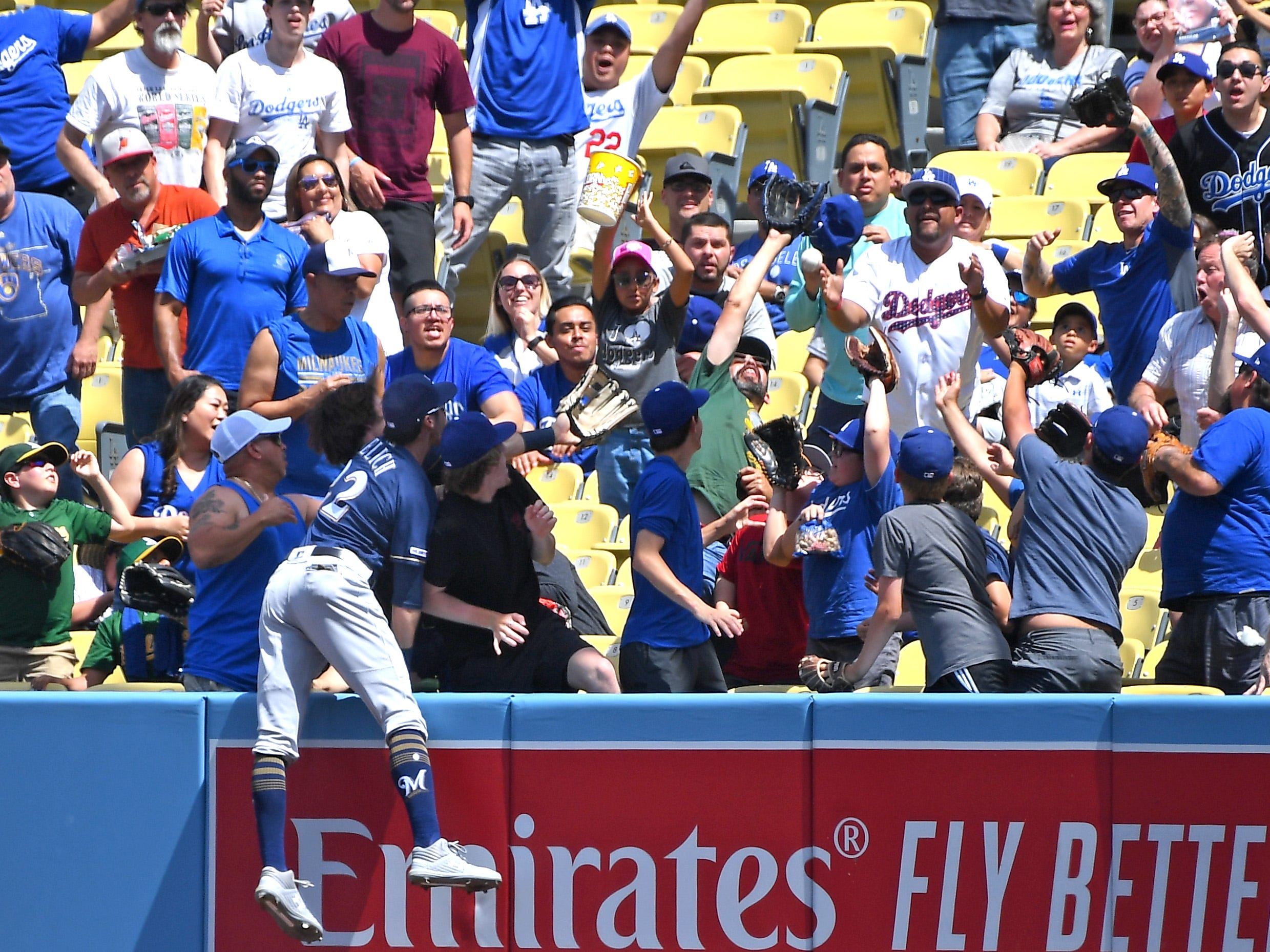 Brewers right fielder Christian Yelich can't reach Joc Pederson's home run Sunday afternoon.