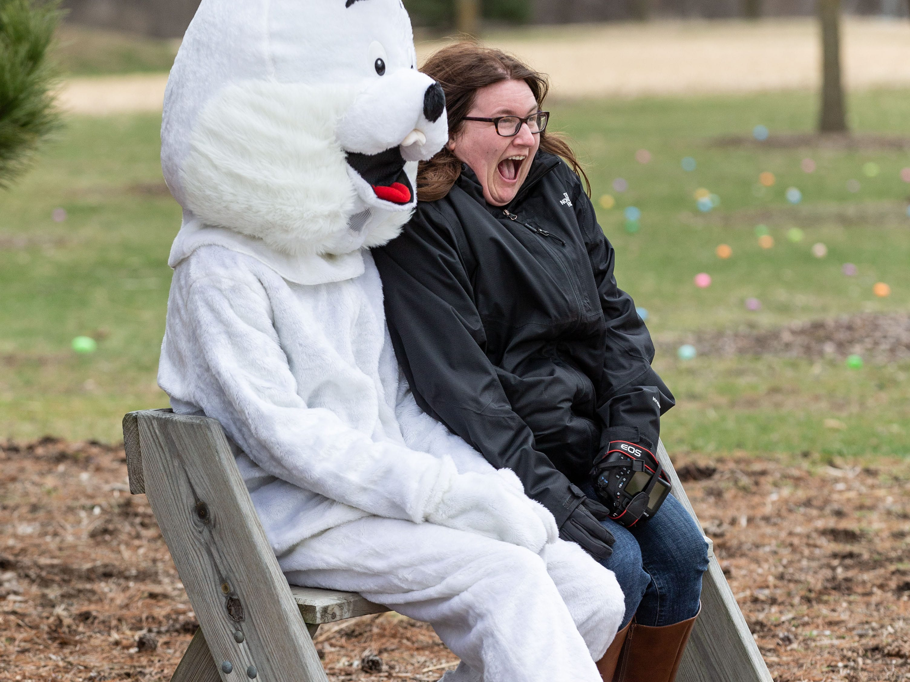 Amber Tyler of DeForest recreates a childhood photo with the Easter Bunny during the annual Easter Extravaganza egg hunt in Lisbon Community Park on Saturday, April 13, 2019. Sponsored by the Lisbon Park Department, the hunt features treats from area businesses and organizations, pictures with the Easter Bunny, local emergency response vehicles and more.