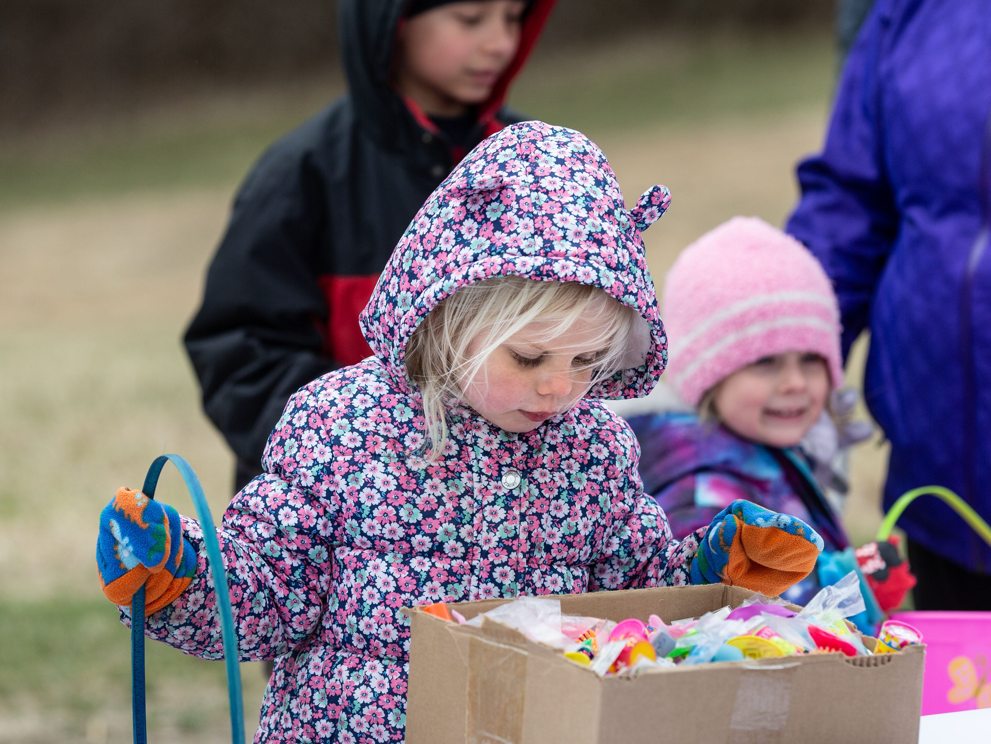Three-year-old Madeline DeKeyser of Oconomowoc pauses to select a toy during the annual Easter Extravaganza egg hunt in Lisbon Community Park on Saturday, April 13, 2019. Sponsored by the Lisbon Park Department, the hunt features treats from area businesses and organizations, pictures with the Easter Bunny, local emergency response vehicles and more.