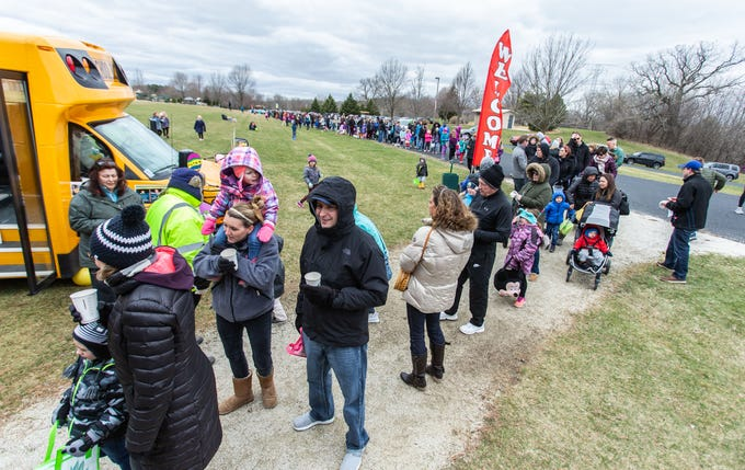 Visitors fend off a cold breeze as they wait for the start of the annual Easter Extravaganza egg hunt at Lisbon Community Park on Saturday, April 13, 2019. Sponsored by the Lisbon Park Department, the hunt features treats from area businesses and organizations, pictures with the Easter Bunny, local emergency response vehicles and more.