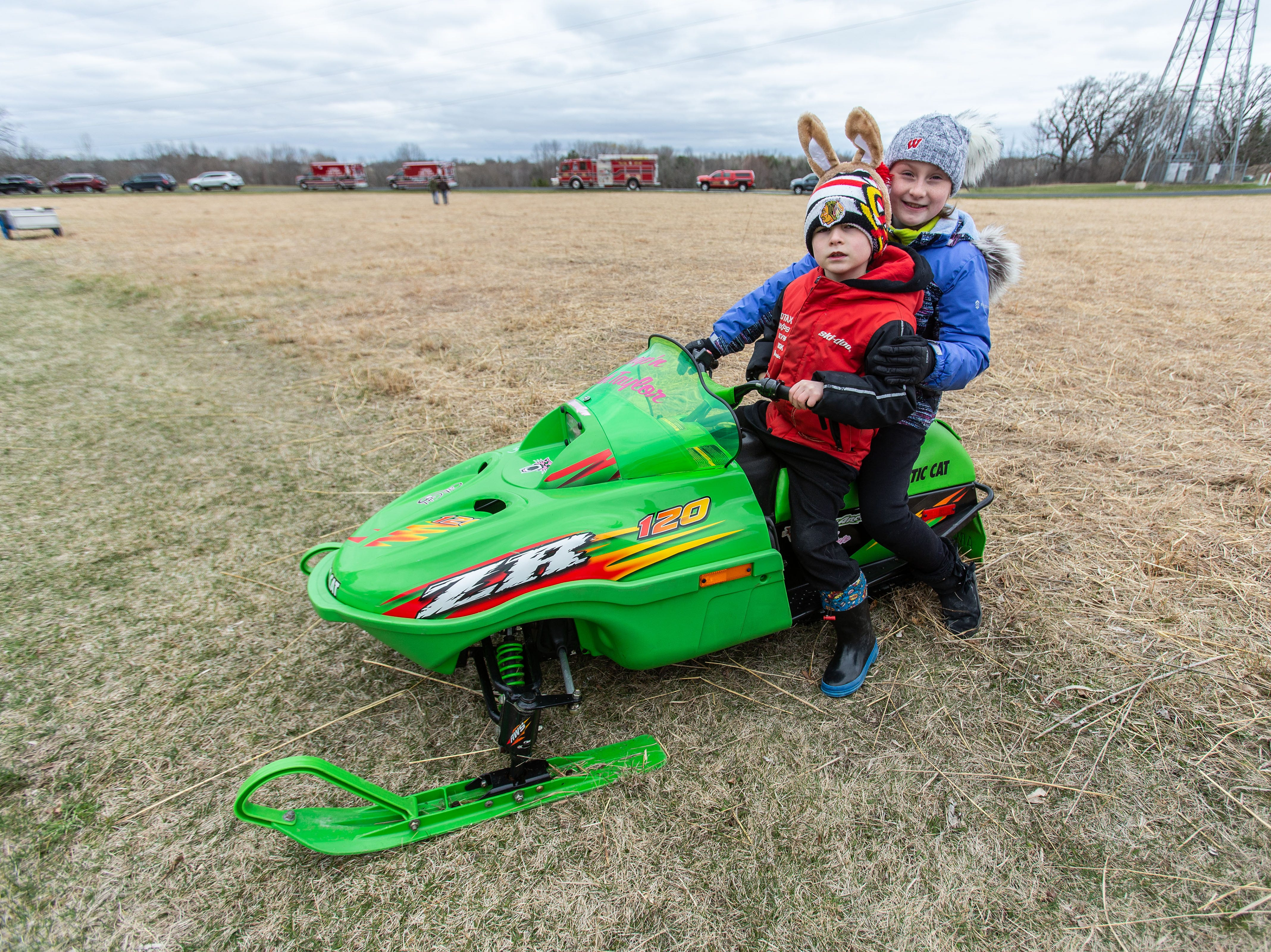 Cole Taylor, 6, and his sister Leah, 9, of Sussex pose for a photo at the Sussex Sled Bugs display during the annual Easter Extravaganza egg hunt in Lisbon Community Park on Saturday, April 13, 2019. Sponsored by the Lisbon Park Department, the hunt features treats from area businesses and organizations, pictures with the Easter Bunny, local emergency response vehicles and more.