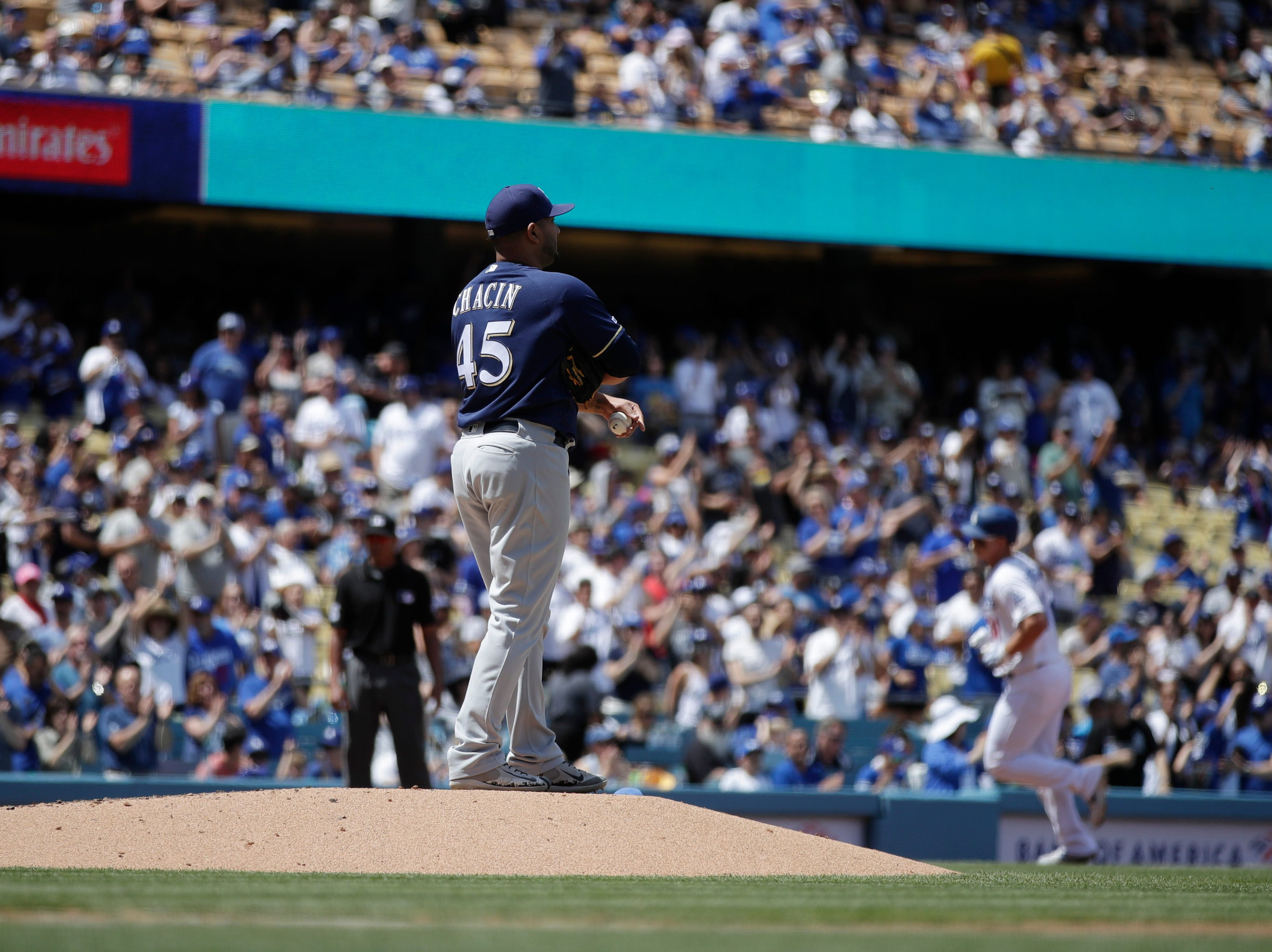 Brewers starting pitcher Jhoulys Chacin stands on the mound as Los Angeles Dodgers' Joc Pederson rounds the bases after hitting a home run in the second inning Sunday.