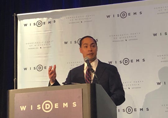 Julian Castro, the former mayor of San Antonio and Housing and Urban Development secretary under President Barack Obama, speaks to a crowd at a Democratic Party Founders Day dinner in Milwaukee. Castro is running for president and came to Wisconsin to drum up Democratic support.
