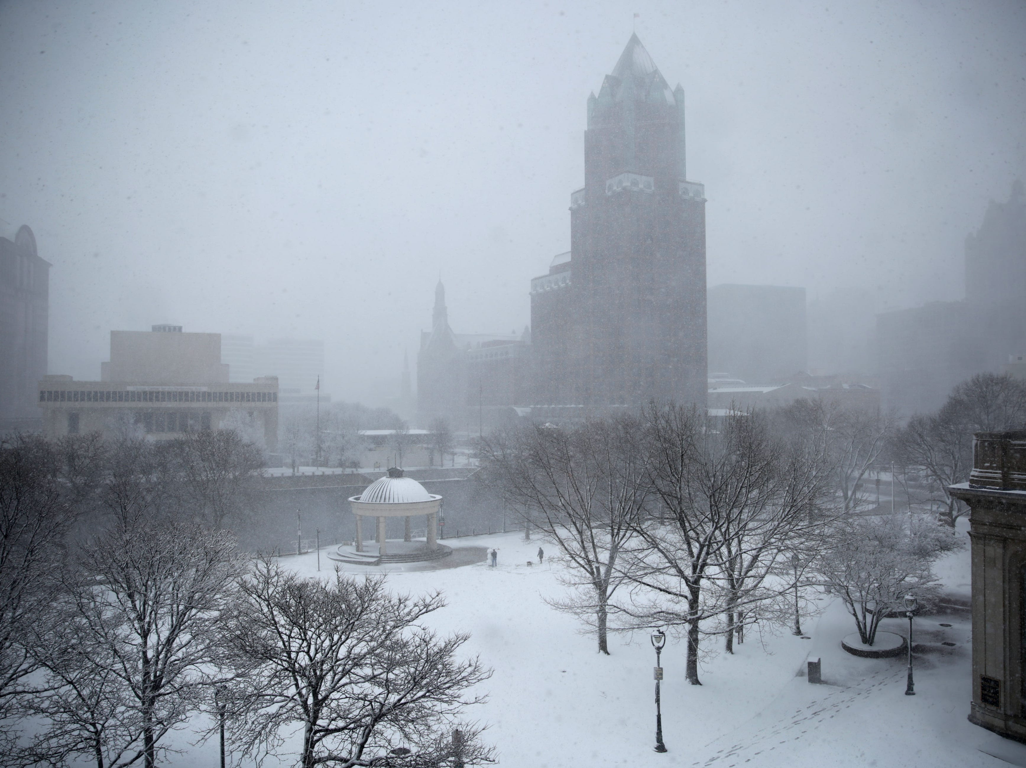 Snow falls on Pere Marquette Park in Milwaukee.
