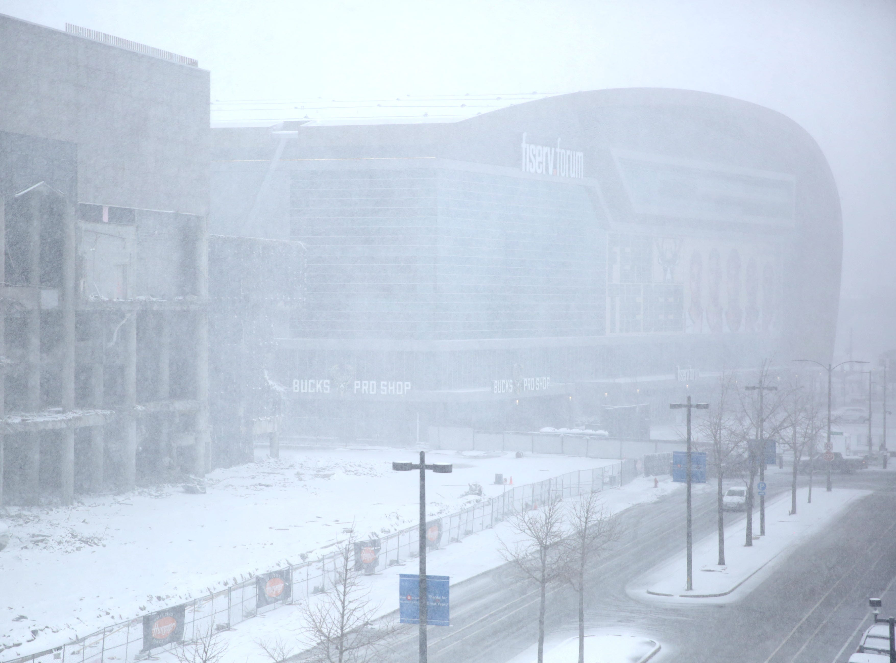 Snow surrounds Fiserv Forum before the Milwaukee Bucks play game one of the NBA playoffs in Milwaukee on Sunday.