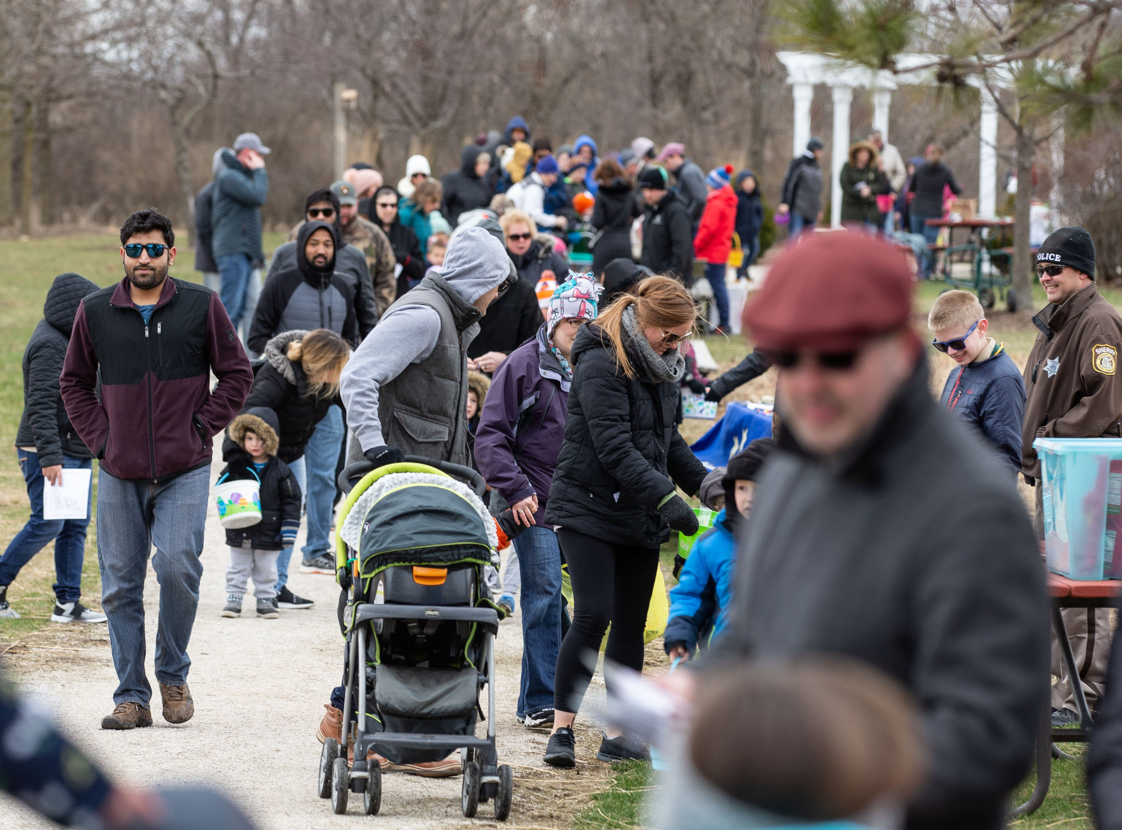 Visitors stream into Lisbon Community Park for the start of the annual Easter Extravaganza egg hunt on Saturday, April 13, 2019. Sponsored by the Lisbon Park Department, the hunt features treats from area businesses and organizations, pictures with the Easter Bunny, local emergency response vehicles and more.