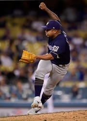 Junior Guerra picks up his first major-league save as he tosses two scoreless innings for the Brewers against the Dodgers on Saturday.