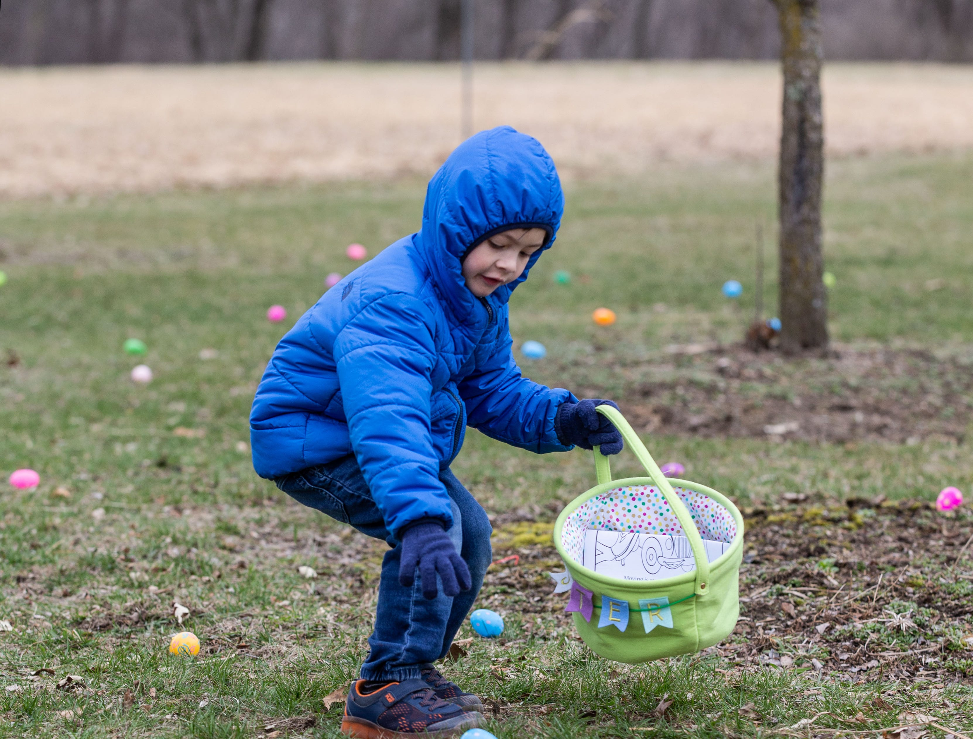 Five-year-old Benjamin Trautner of Menomonee Falls gathers eggs during the annual Easter Extravaganza egg hunt in Lisbon Community Park on Saturday, April 13, 2019. Sponsored by the Lisbon Park Department, the hunt features treats from area businesses and organizations, pictures with the Easter Bunny, local emergency response vehicles and more.
