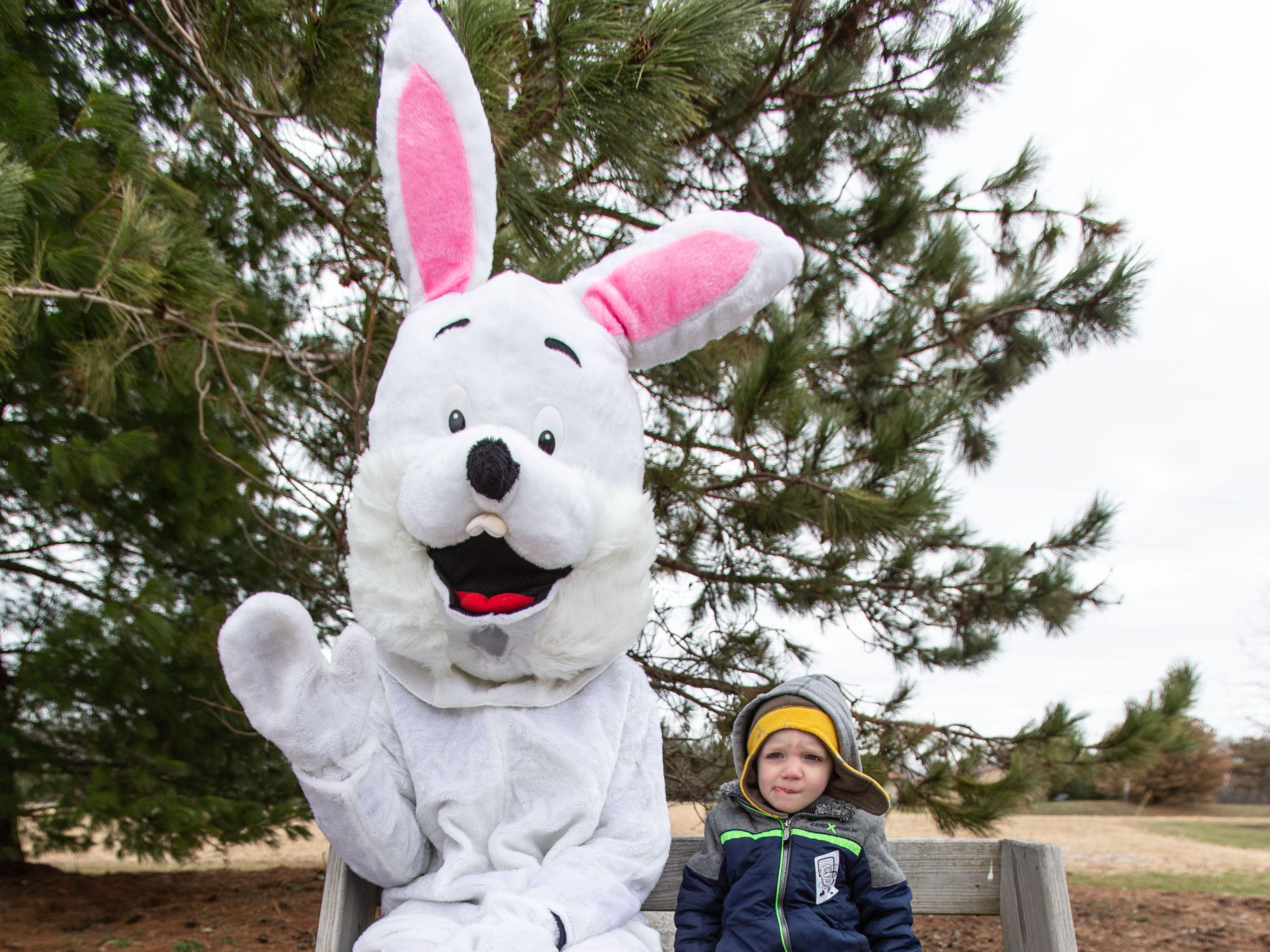 Three-year-old Deaglan Beier of Sussex sits for a photo with the Easter Bunny during the annual Easter Extravaganza egg hunt in Lisbon Community Park on Saturday, April 13, 2019. Sponsored by the Lisbon Park Department, the hunt features treats from area businesses and organizations, pictures with the Easter Bunny, local emergency response vehicles and more.