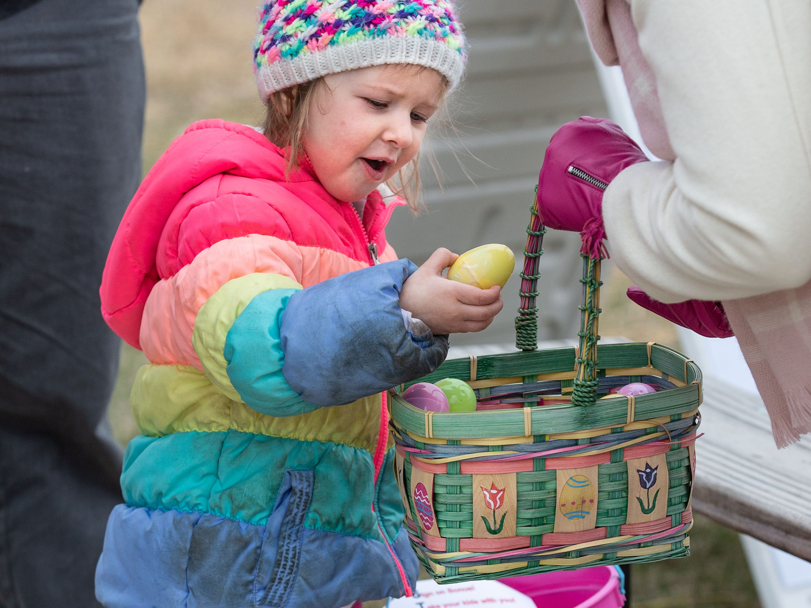 Three-year-old Lucy Guerino of Waukesha selects a candy filled egg during the annual Easter Extravaganza egg hunt in Lisbon Community Park on Saturday, April 13, 2019. Sponsored by the Lisbon Park Department, the hunt features treats from area businesses and organizations, pictures with the Easter Bunny, local emergency response vehicles and more.