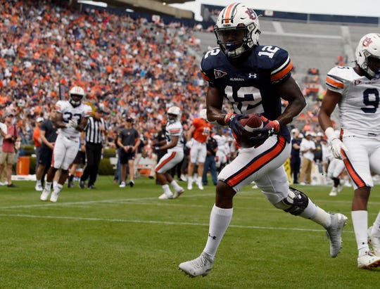 Auburn wide receiver Eli Stove catches a touchdown on A-Day on Saturday, April 13, 2019 in Auburn, Ala.