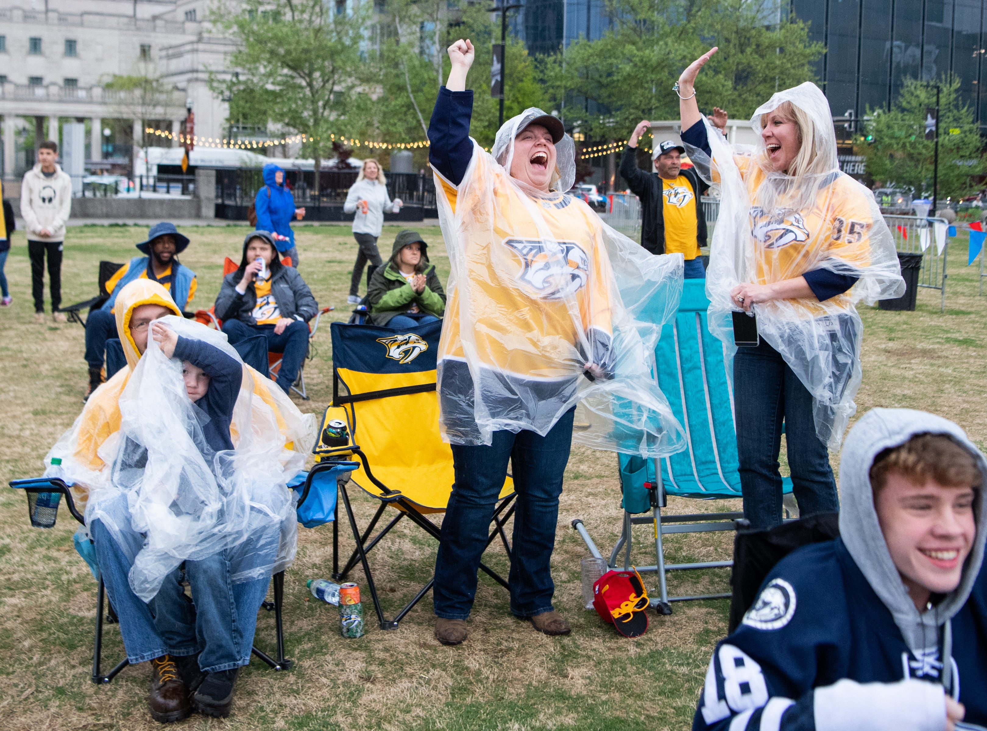 Pam Pegram and Becca, Jared, and JD Conrey (from right) celebrate the Nashville Predators' goal against the Dallas Stars during the second period at Preds Party in the Park at Walk of Fame Park Saturday, April 13, 2019, in Nashville, Tenn.