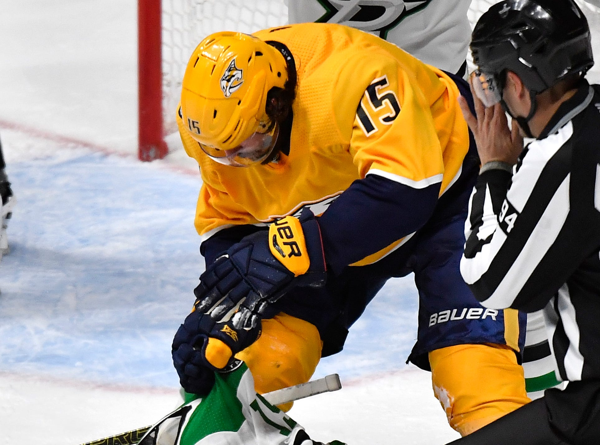 Nashville Predators right wing Craig Smith (15) fights Dallas Stars left wing Blake Comeau (15) during the third period of the divisional semifinal game at Bridgestone Arena in Nashville, Tenn., Saturday, April 13, 2019.