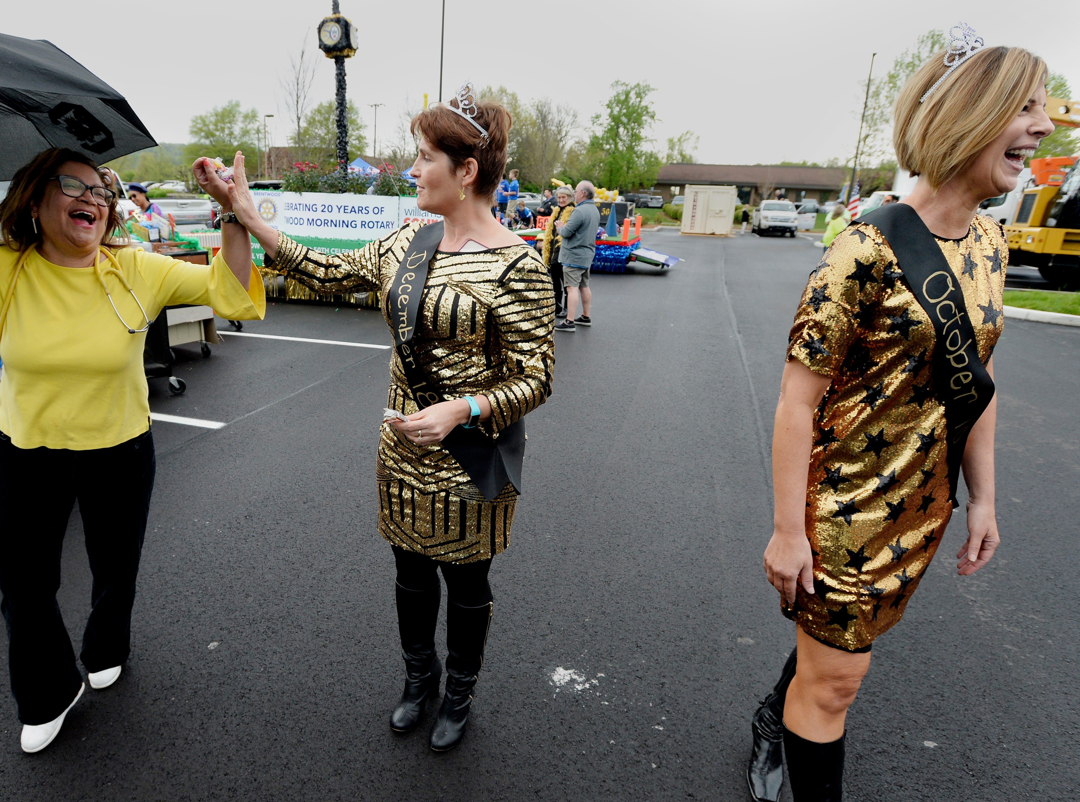 """Stacy Elliott, center, Melissa Oliver, right, and Nedra Jackson joke around before the start of Brentwood's """"A Golden Gallop"""" parade celebrating its 50th year as a community on Saturday, April 13, 2019, in Brentwood, Tenn."""