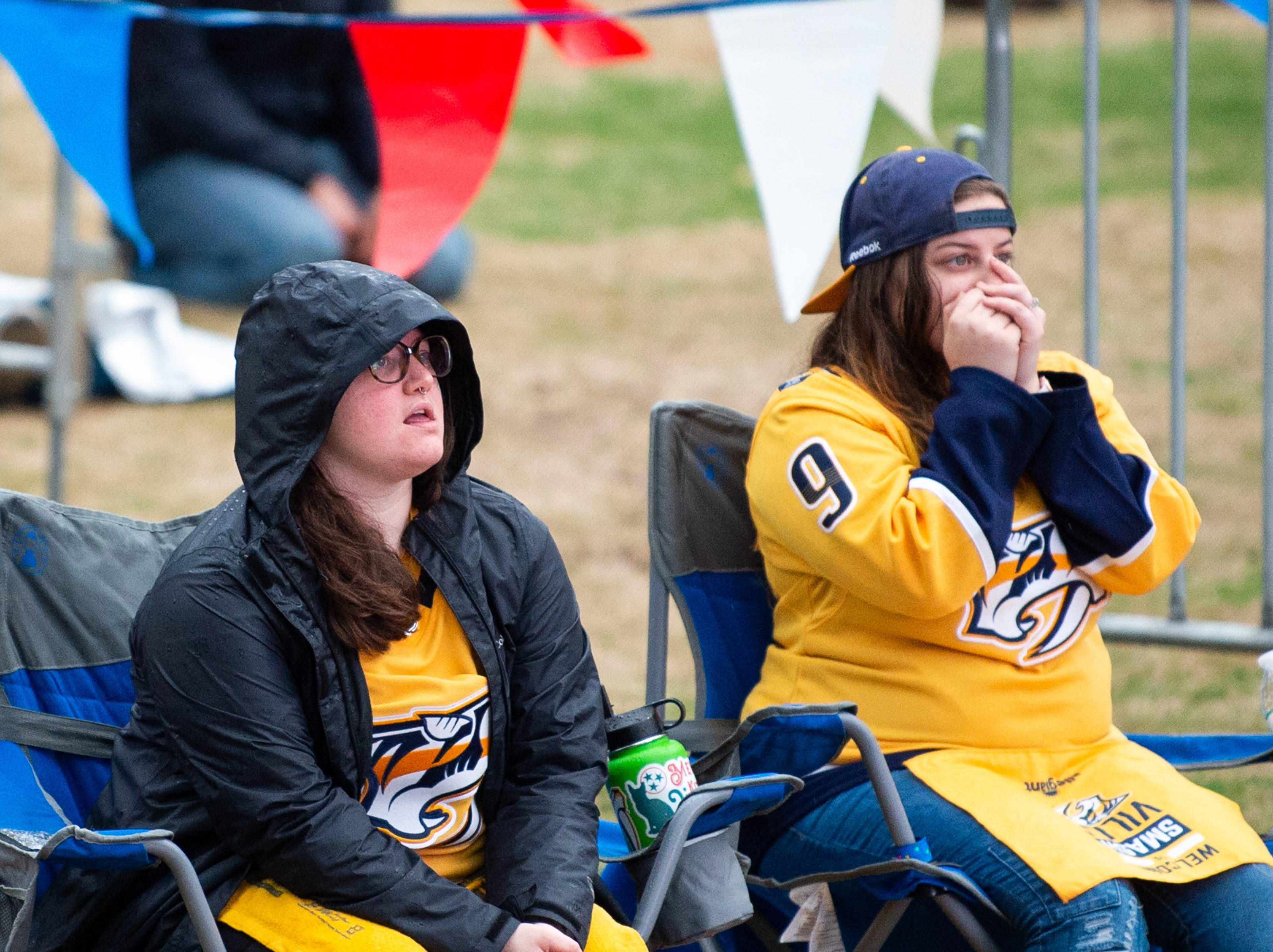 Sisters Kelly and Sophia Campbell watch the second period of the Nashville Predators game against the Dallas Stars at Preds Party in the Park at Walk of Fame Park Saturday, April 13, 2019, in Nashville, Tenn.