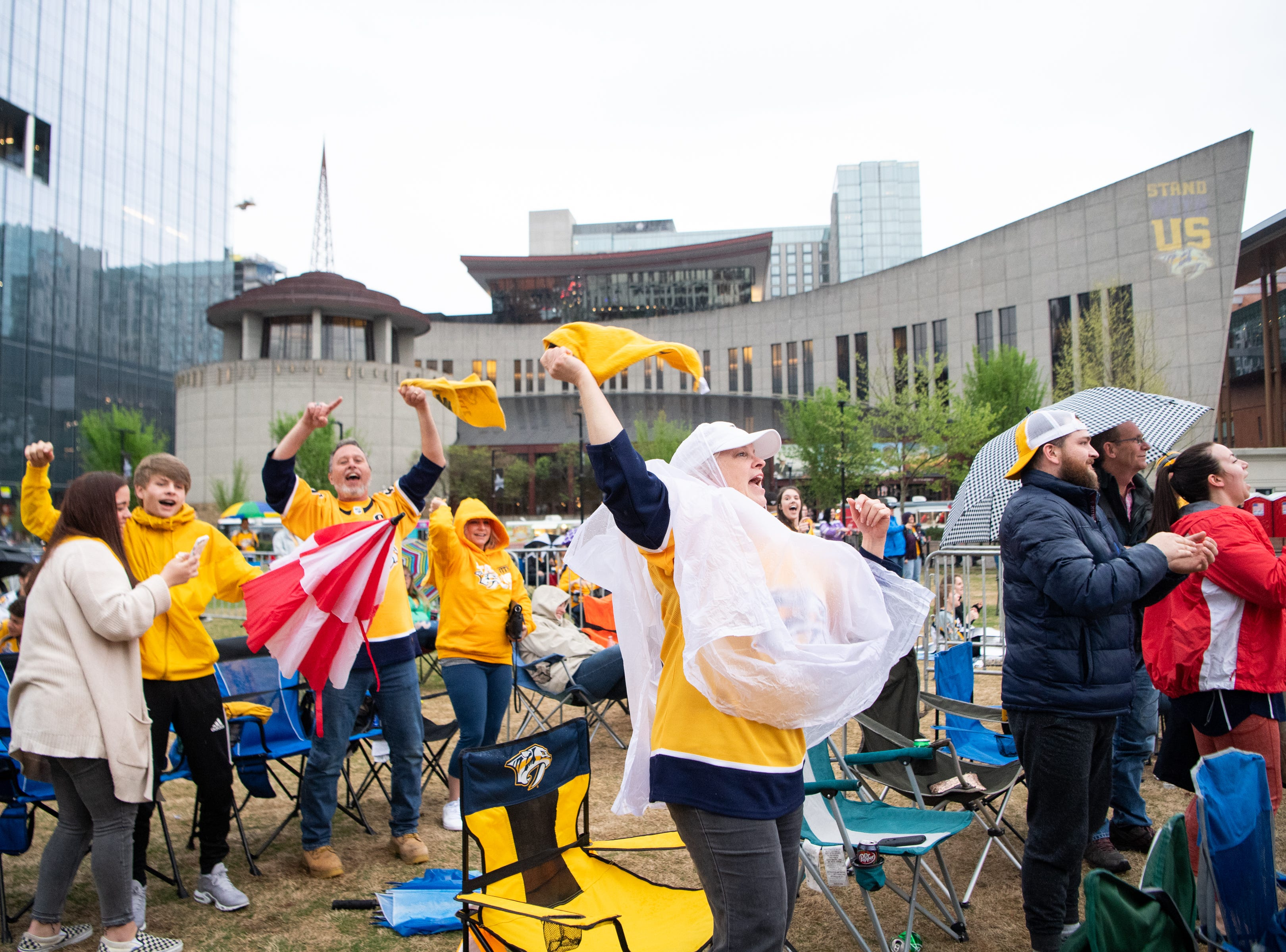Lori Cunningham (center) celebrates the Nashville Predators' goal against the Dallas Stars during the second period at Preds Party in the Park at Walk of Fame Park Saturday, April 13, 2019, in Nashville, Tenn.