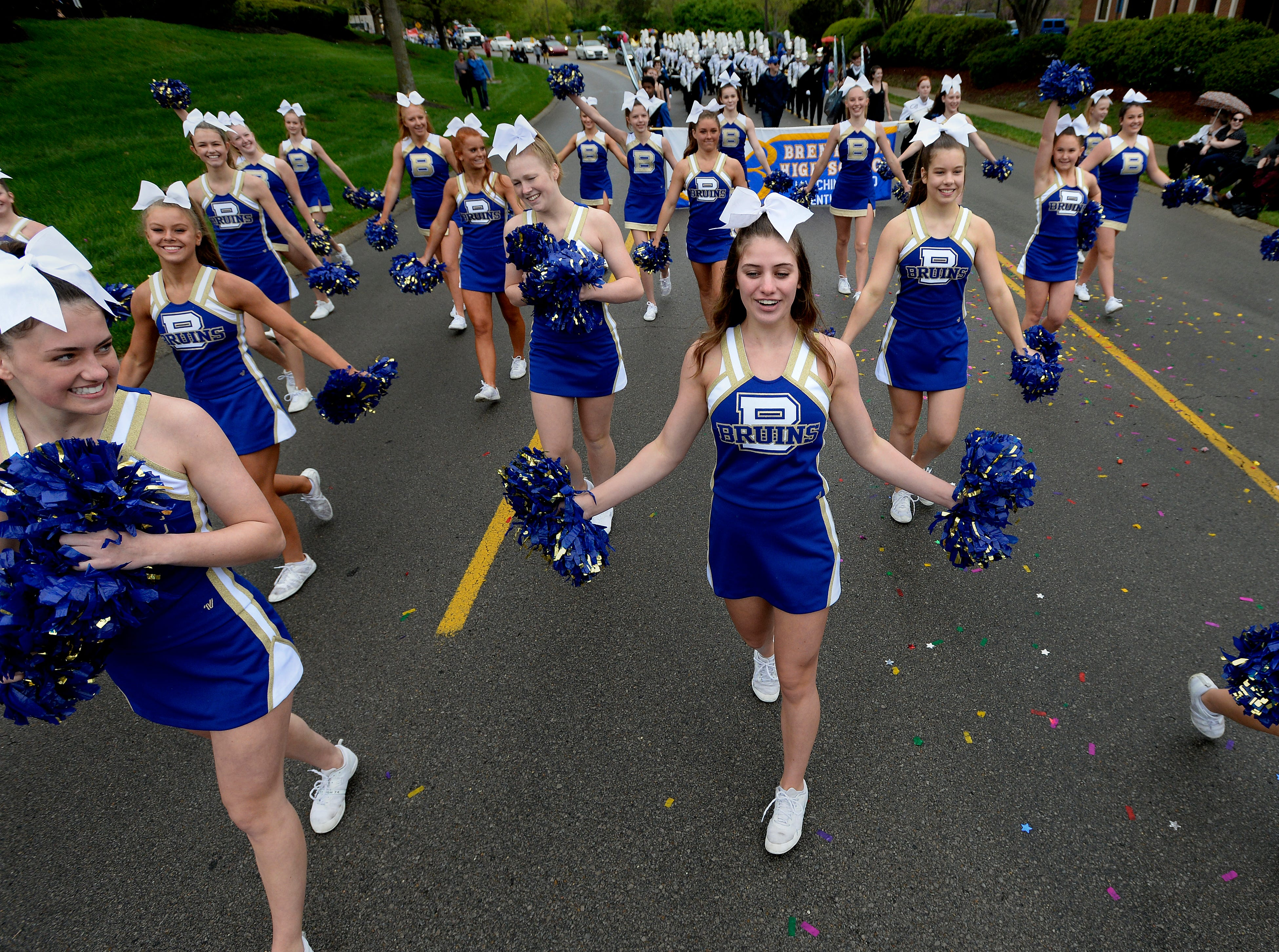 """The Brentwood High School cheerleaders and marching band perform during Brentwood's """"A Golden Gallop"""" parade celebrating its 50th year as a community on Saturday, April 13, 2019, in Brentwood, Tenn."""