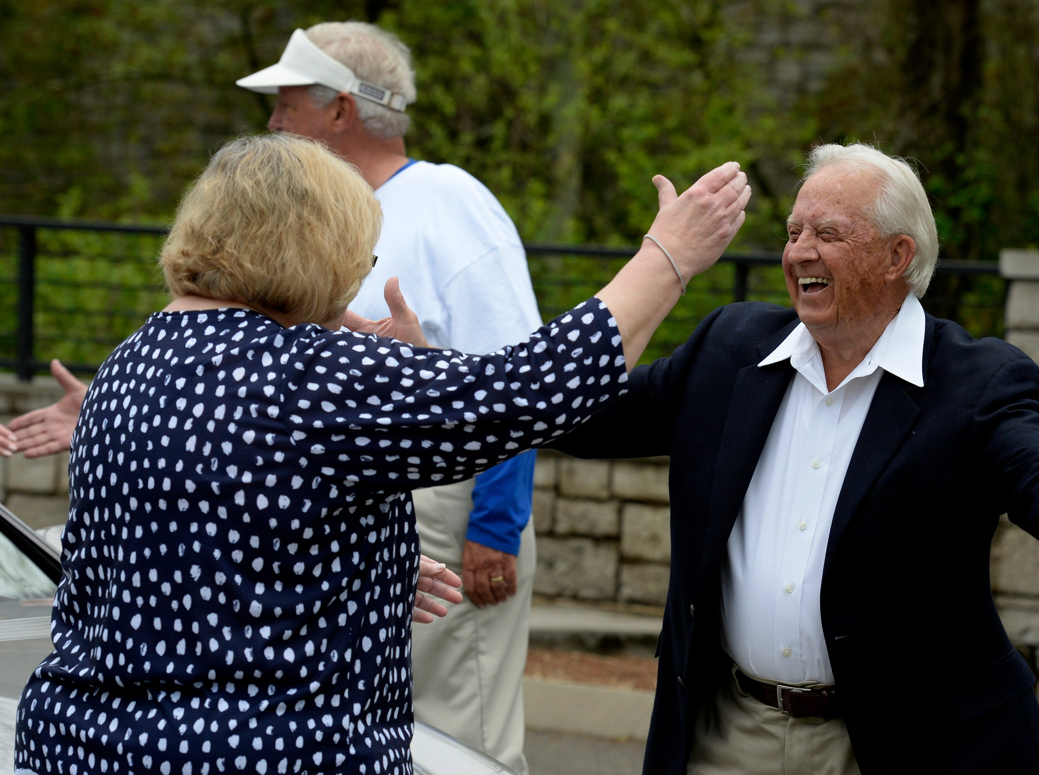 """Grand Marshal Jim Redd is greeted by Betsy Crosley before the start of Brentwood's """"A Golden Gallop"""" parade celebrating its 50th year as a community on Saturday, April 13, 2019, in Brentwood, Tenn."""