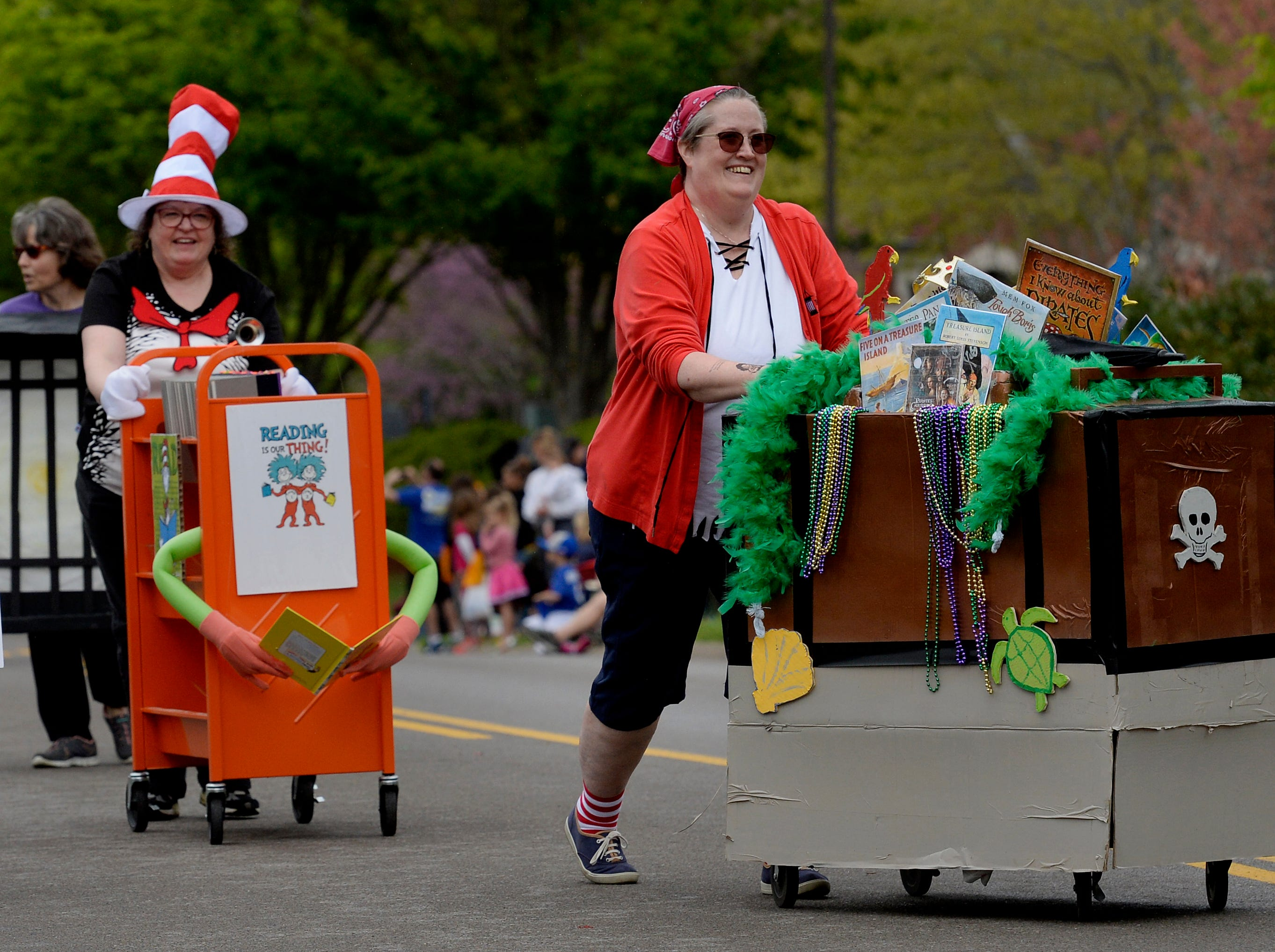 """Brentwood librarians participate in Brentwood's """"A Golden Gallop"""" parade celebrating its 50th year as a community on Saturday, April 13, 2019, in Brentwood, Tenn."""
