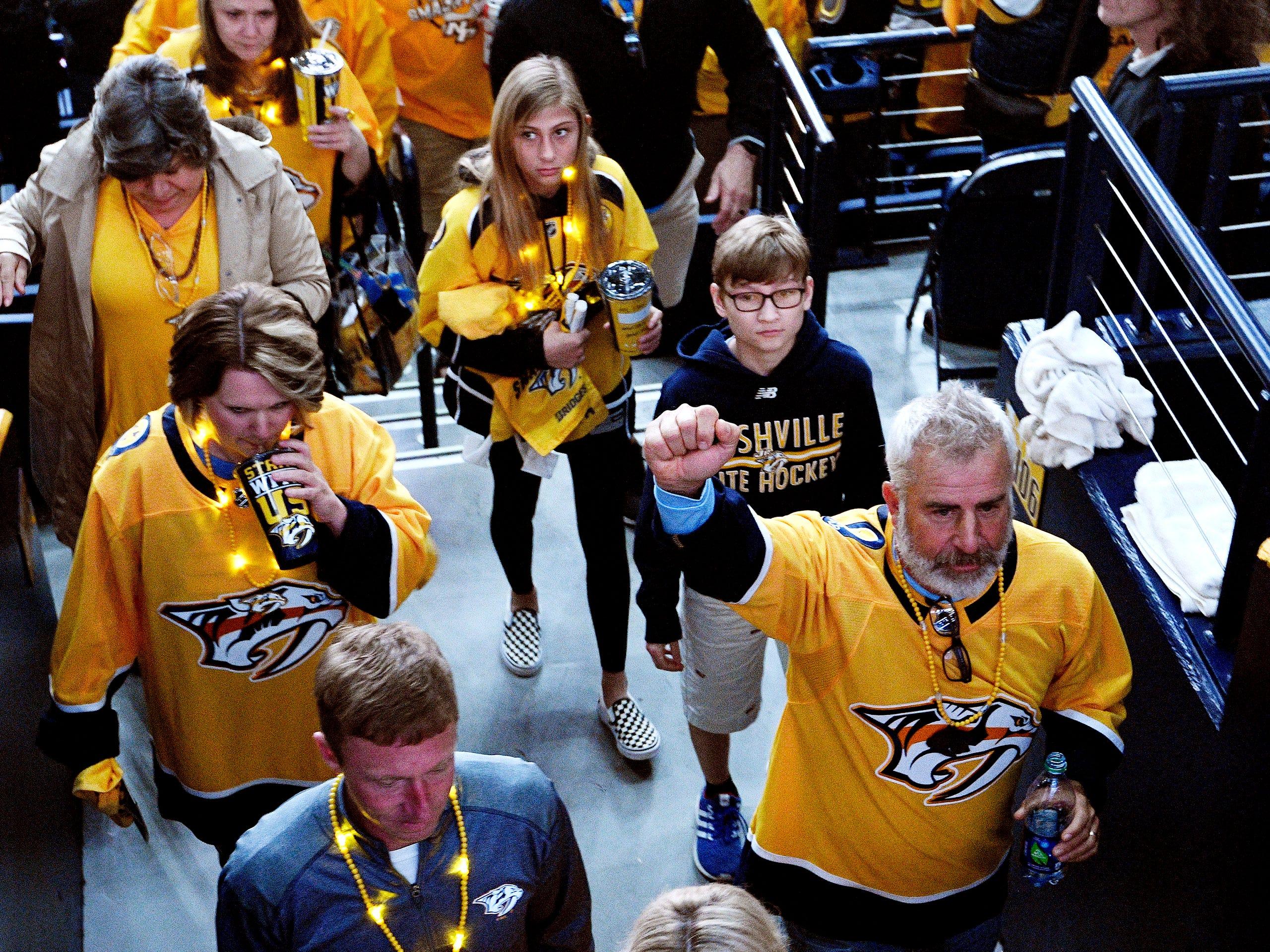 Predators fans celebrate after the 2-1 overtime win over the Dallas Stars in the divisional semifinal game at Bridgestone Arena in Nashville, Tenn., Saturday, April 13, 2019.
