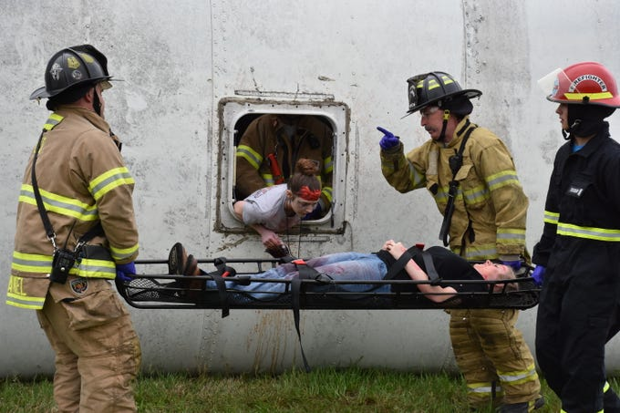 A large-scale, mass-casualty emergency training drill took place at the Dickson County Fairgrounds on Highway 47 on Friday morning. Thirty Creek Wood High School students were part of the exercise. The drill involved a staged school bus accident and the triage, treatment and transporting of injured patients. Multiple emergency services were involved, including the Dickson Fire Department, Dickson County Emergency Management Agency, Dickson County Emergency Medical Service, Tristar Horizon Medical Center, AirEvac and the Dickson County Board of Education.