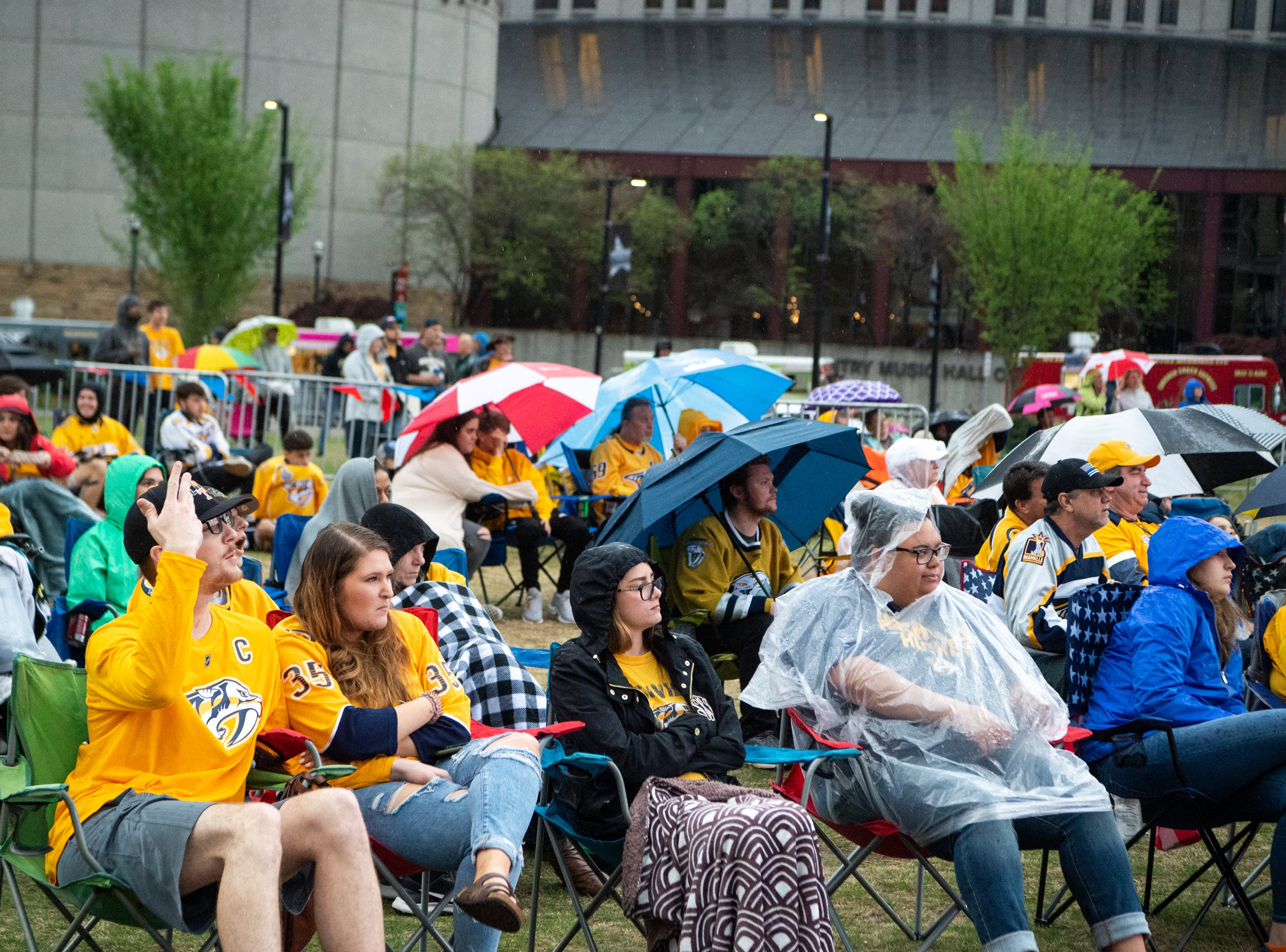 Fans watch the second period of the Nashville Predators game against the Dallas Stars at Preds Party in the Park at Walk of Fame Park Saturday, April 13, 2019, in Nashville, Tenn.