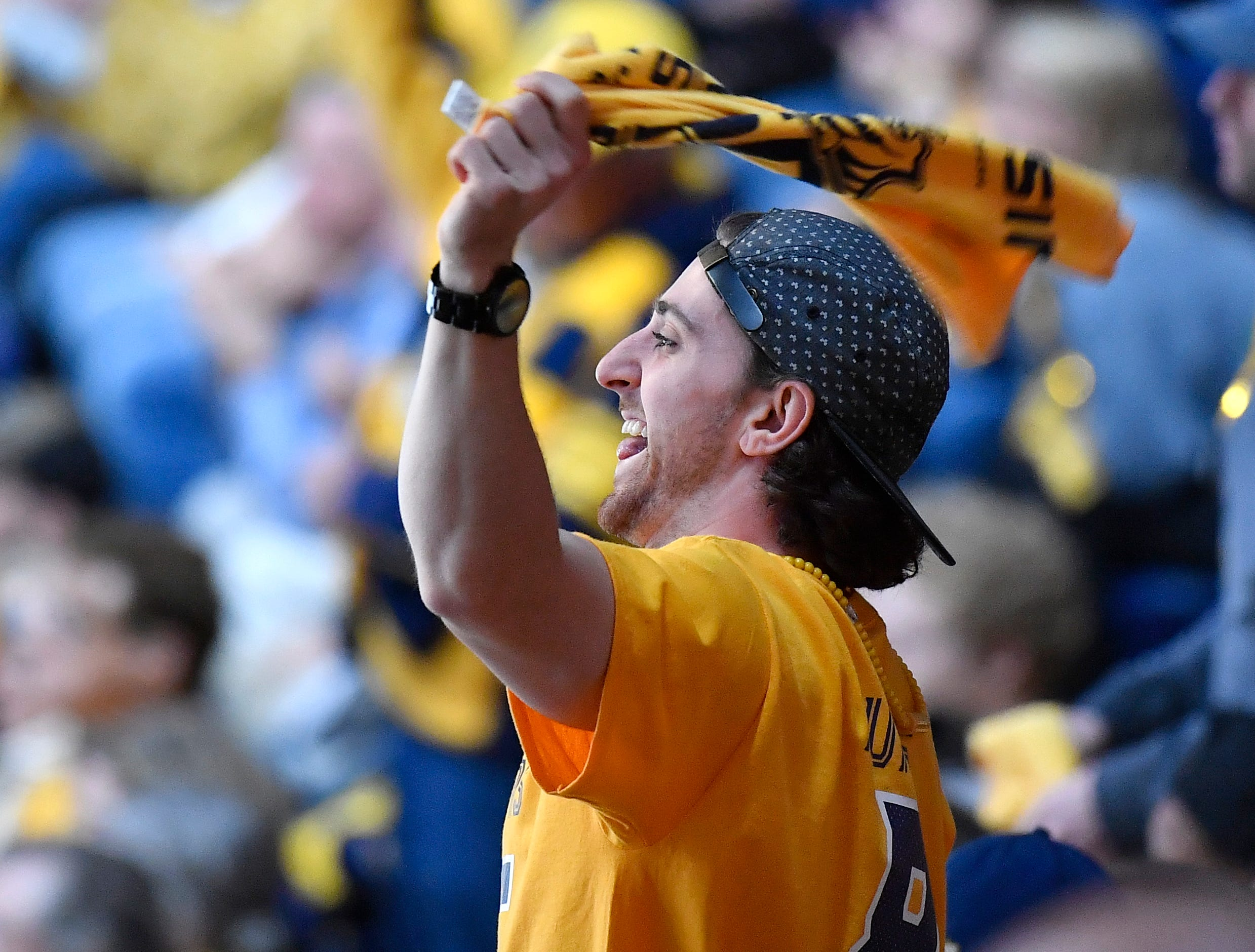 A Predators fan cheers during the third period of the divisional semifinal game at Bridgestone Arena in Nashville, Tenn., Saturday, April 13, 2019.