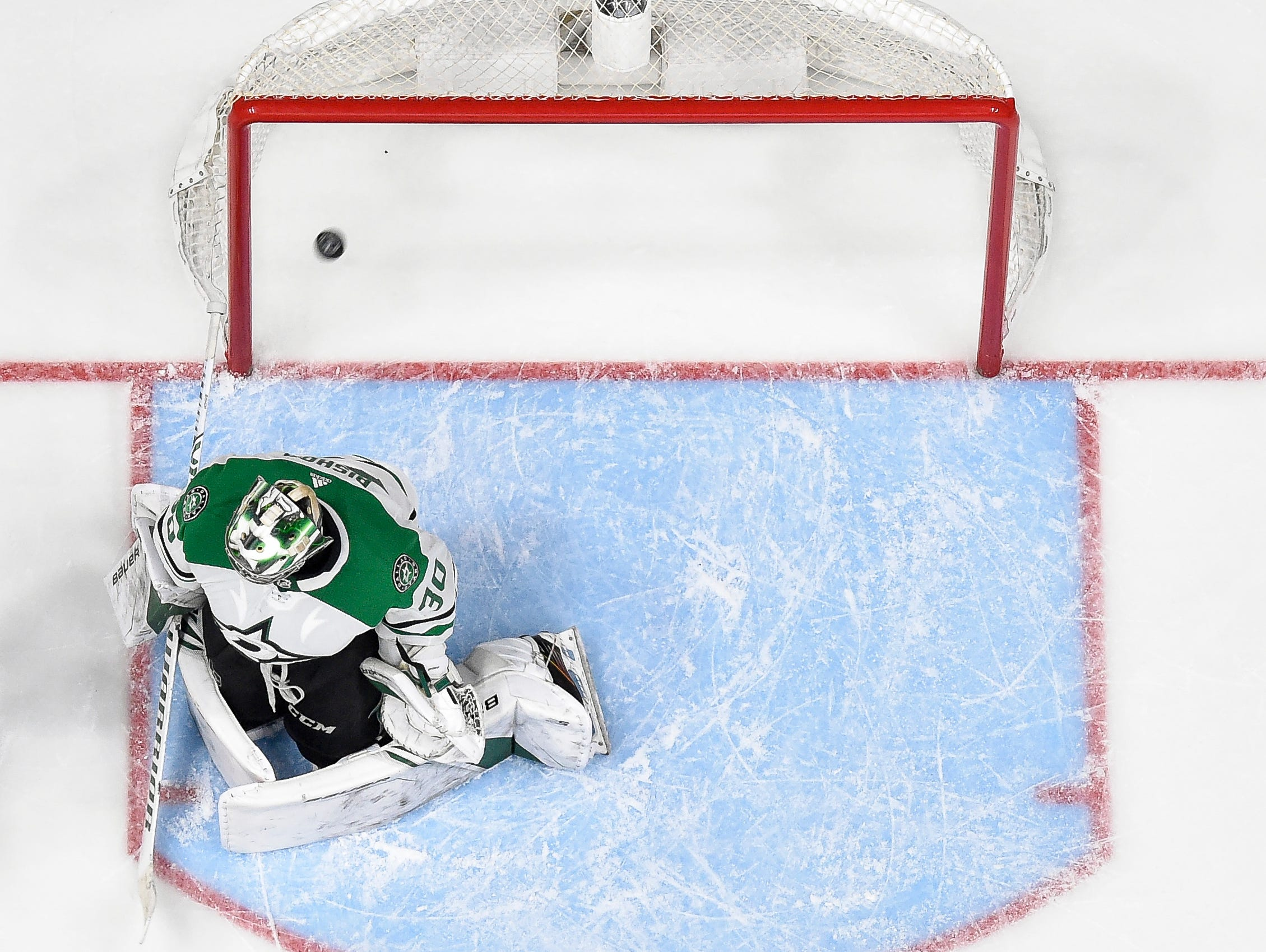 The game winning goal from Nashville Predators right wing Craig Smith lands in the net behind Dallas Stars goaltender Ben Bishop (30) during the overtime period of the divisional semifinal game at Bridgestone Arena in Nashville, Tenn., Wednesday, April 10, 2019.