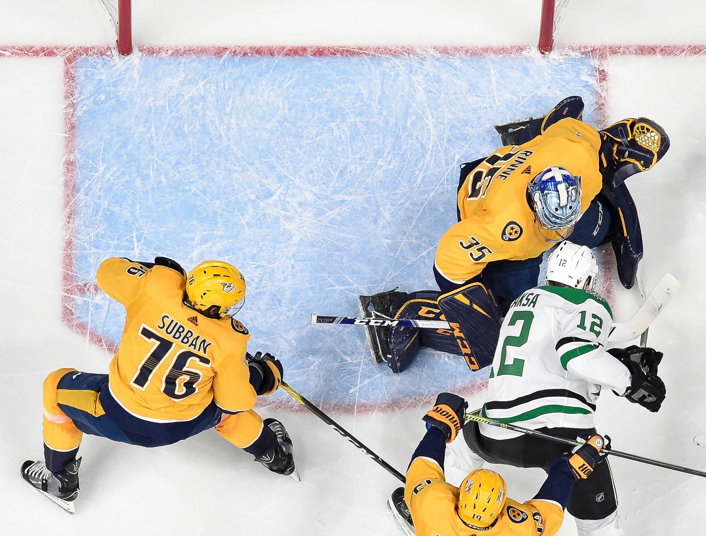 Dallas Stars center Radek Faksa (12) battles Nashville Predators goaltender Pekka Rinne (35) as during the first period of the divisional semifinal game at Bridgestone Arena in Nashville, Tenn., Wednesday, April 10, 2019.