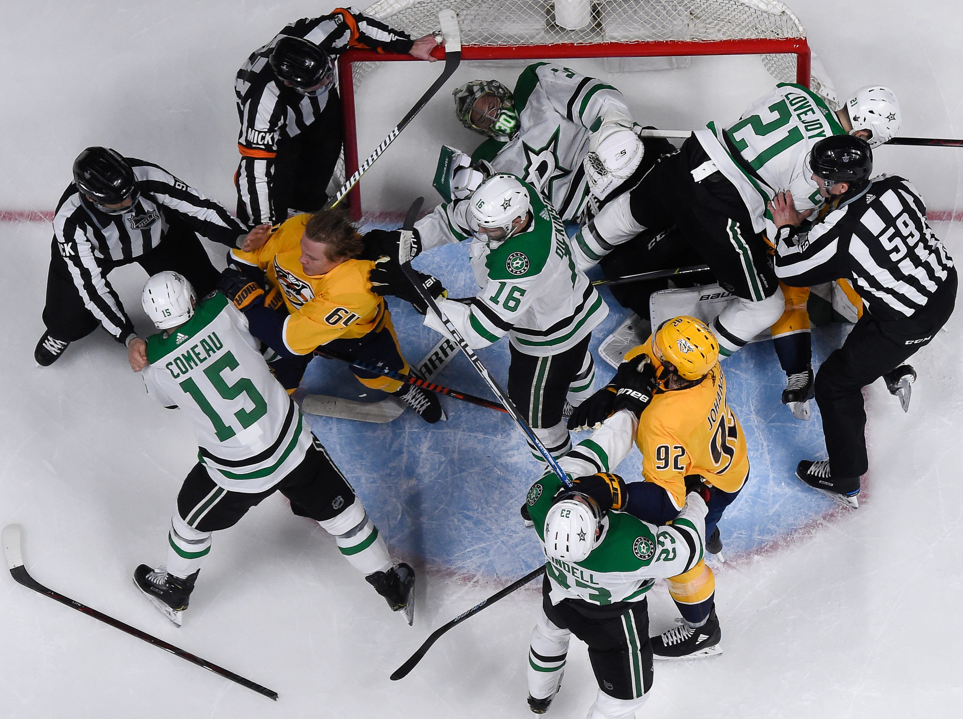 Nashville Predators and Dallas Stars fight in front of the goal during the first period of the divisional semifinal game at Bridgestone Arena Saturday, April 13, 2019 in Nashville, Tenn.