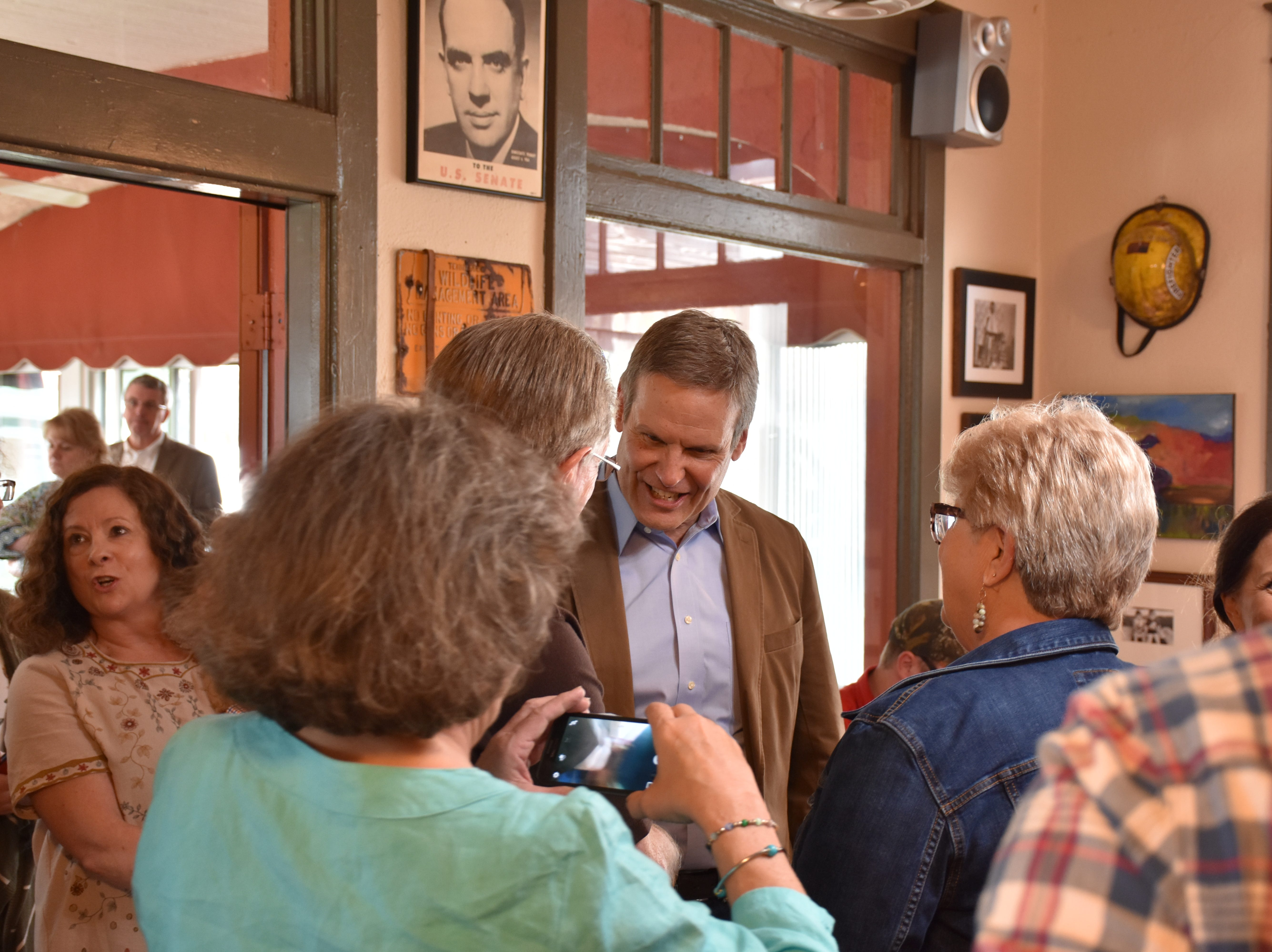 Gov. Bill Lee visits Downtown Dickson on Friday afternoon, stopping at Back Alley BBQ to talk to constituents and take questions.