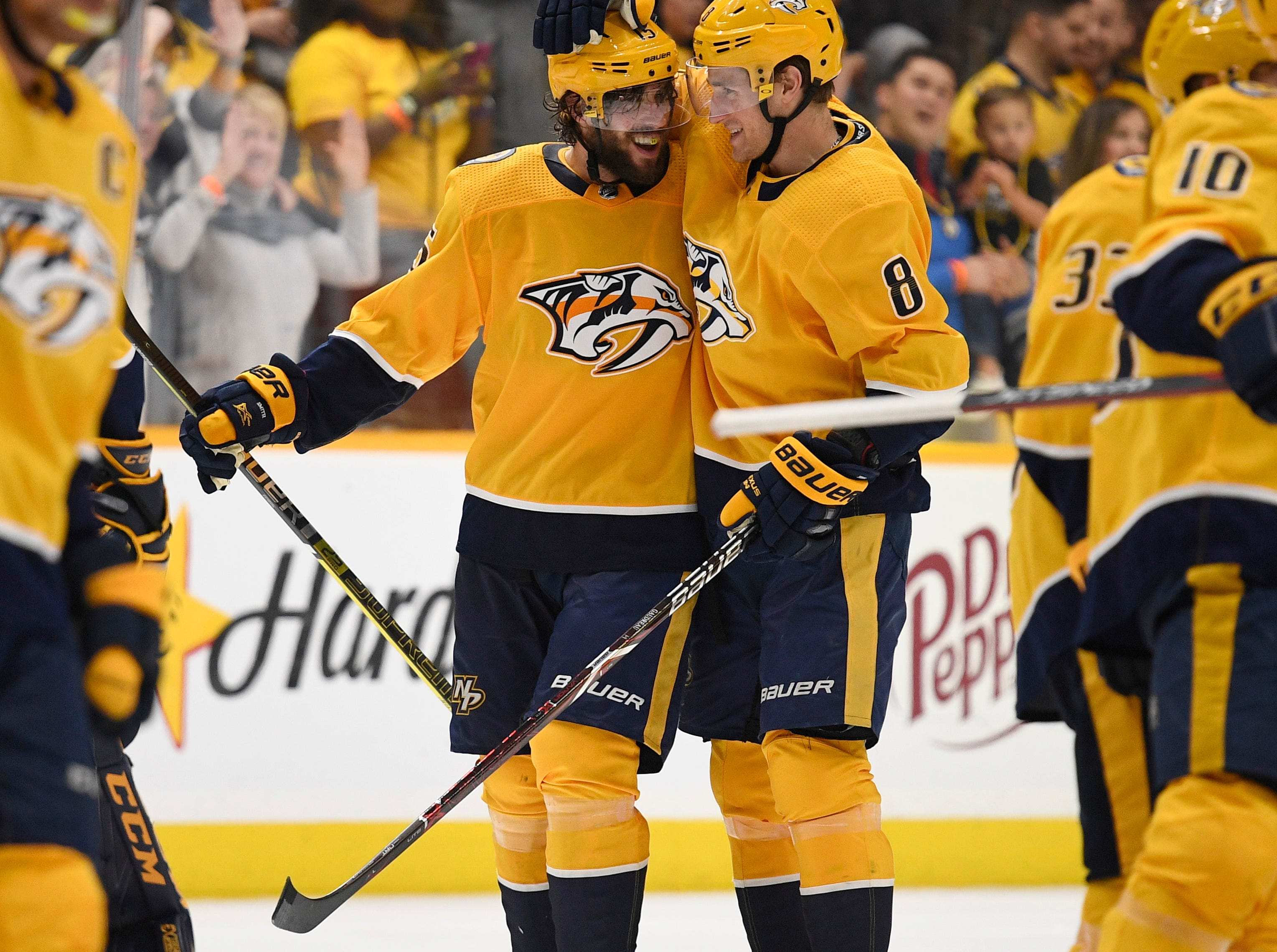 Nashville Predators right wing Craig Smith (15) celebrates with center Kyle Turris (8) after Smith's game-winning goal in overtime to give the Predators a 2-1 win in the divisional semifinal game at Bridgestone Arena in Nashville, Tenn., Saturday, April 13, 2019.