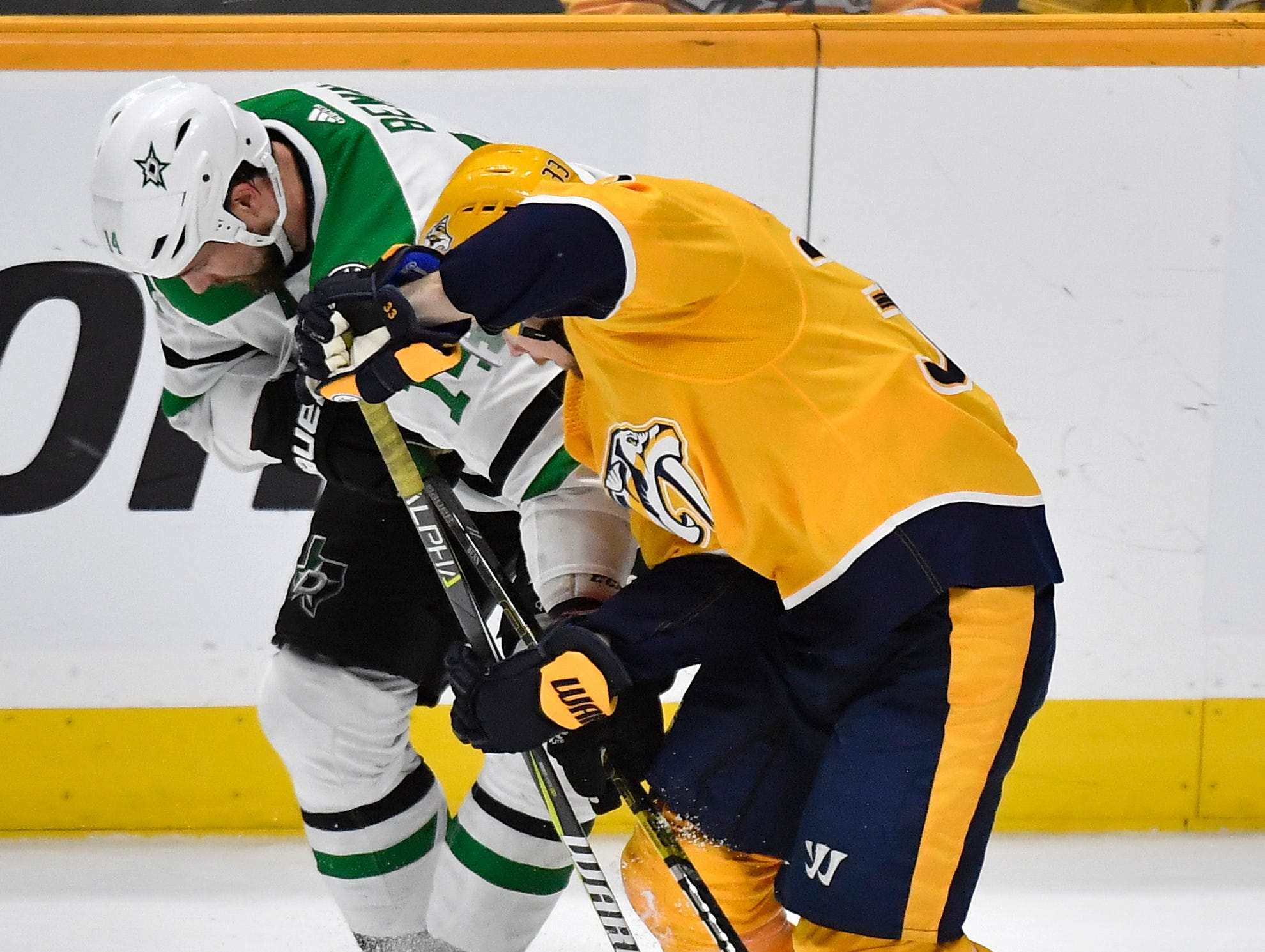 Nashville Predators right wing Viktor Arvidsson (33) and Dallas Stars left wing Jamie Benn (14) battle for the puck during the second period of the divisional semifinal game at Bridgestone Arena in Nashville, Tenn., Saturday, April 13, 2019.