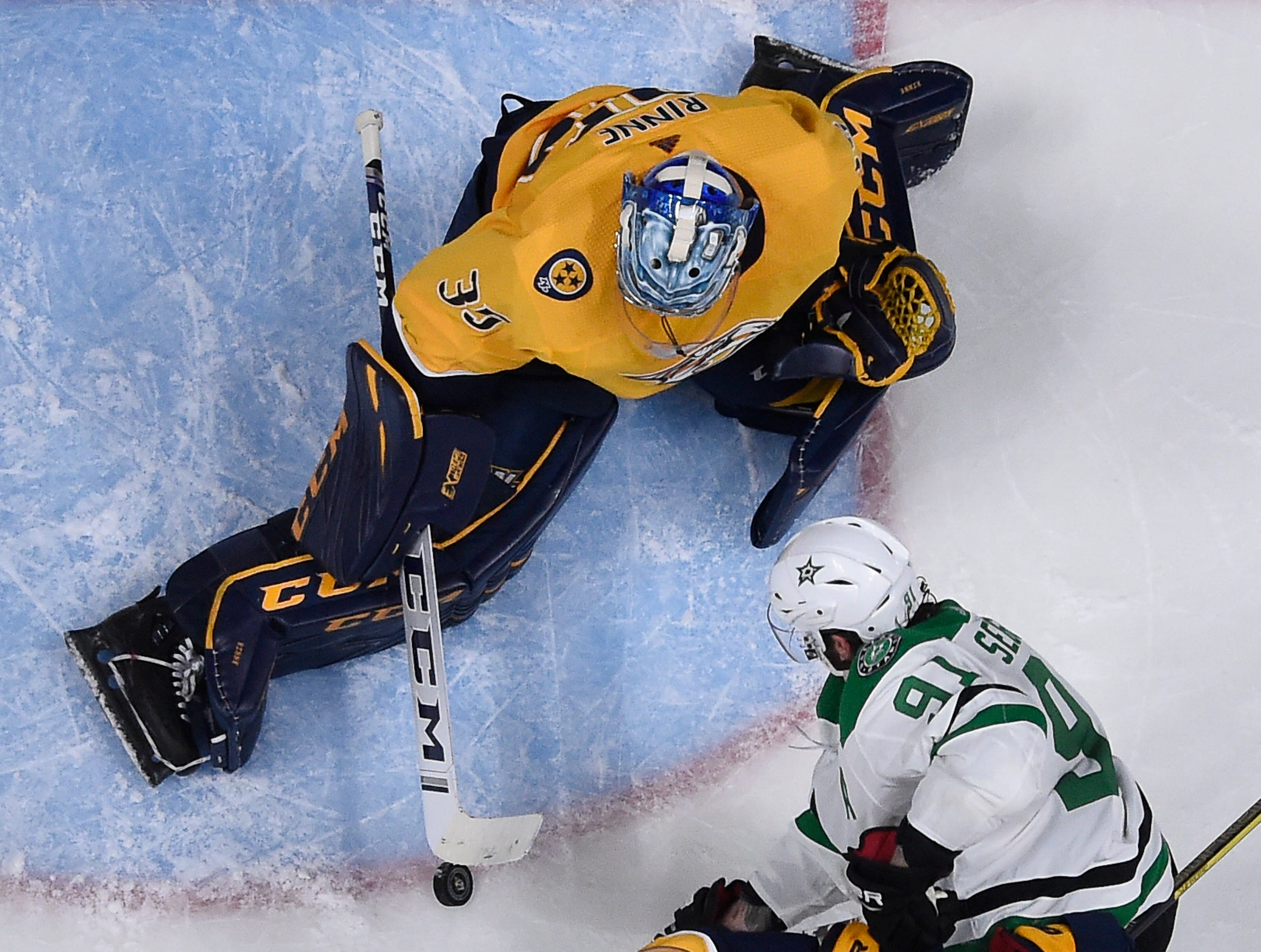 Nashville Predators goaltender Pekka Rinne (35) blocks a shot by Dallas Stars center Tyler Seguin (91) with help for defenseman Dan Hamhuis (5) during the second period of the divisional semifinal game at Bridgestone Arena Saturday, April 13, 2019 in Nashville, Tenn.